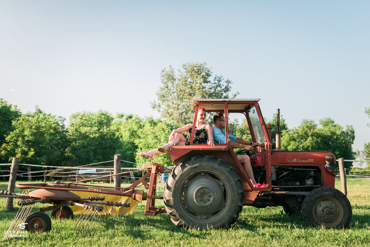 couple on a tractor on a ranch