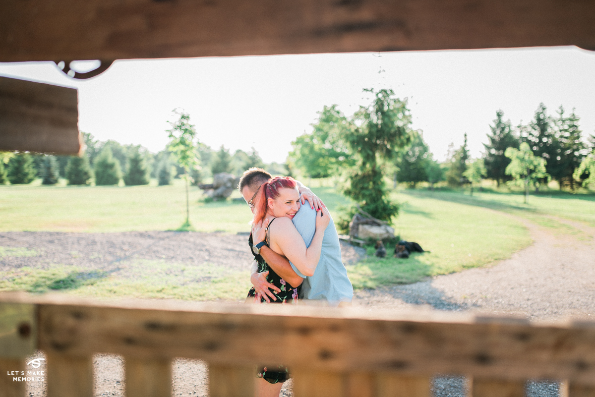 couple hugging on a ranch