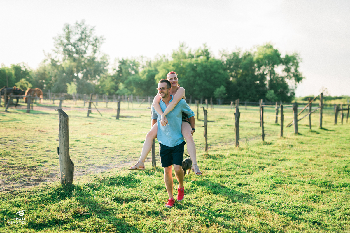 piggyback ride by a married couple on a ranch