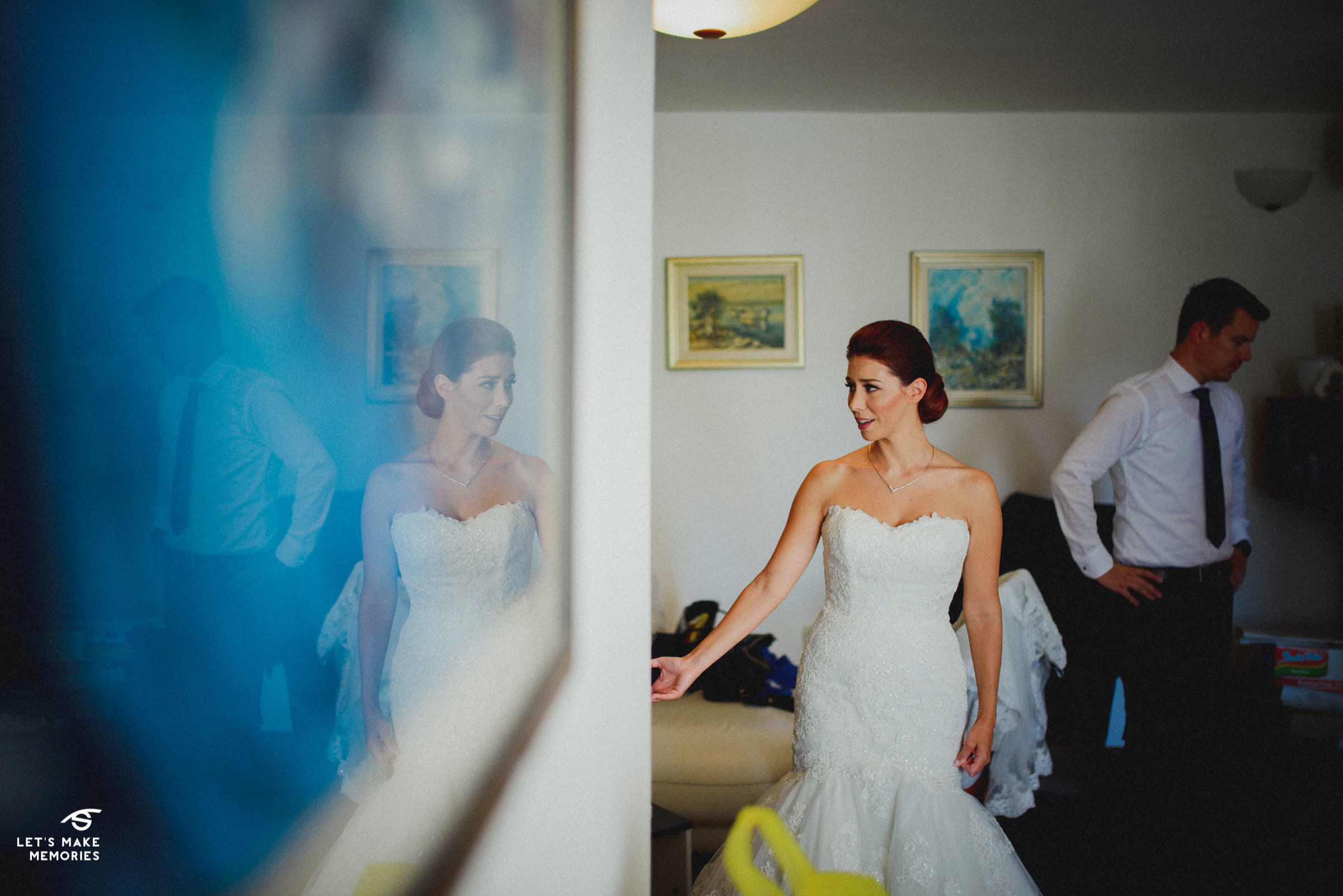 bride greeting her family, reflection shot