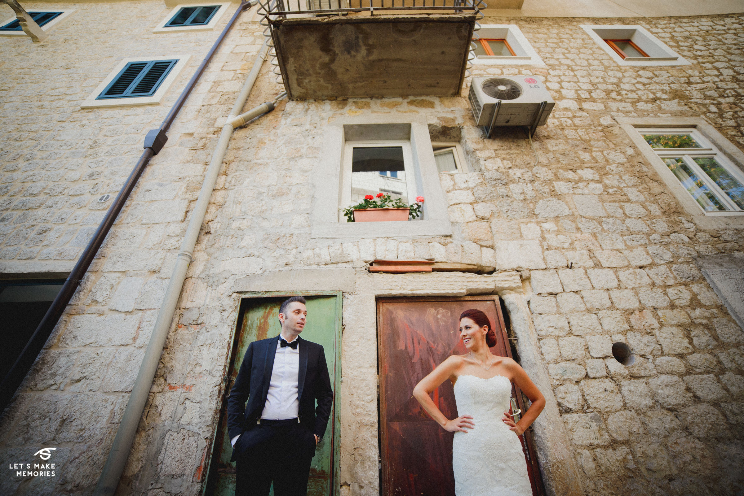 juxtaposition of couple in front of old rusty doors