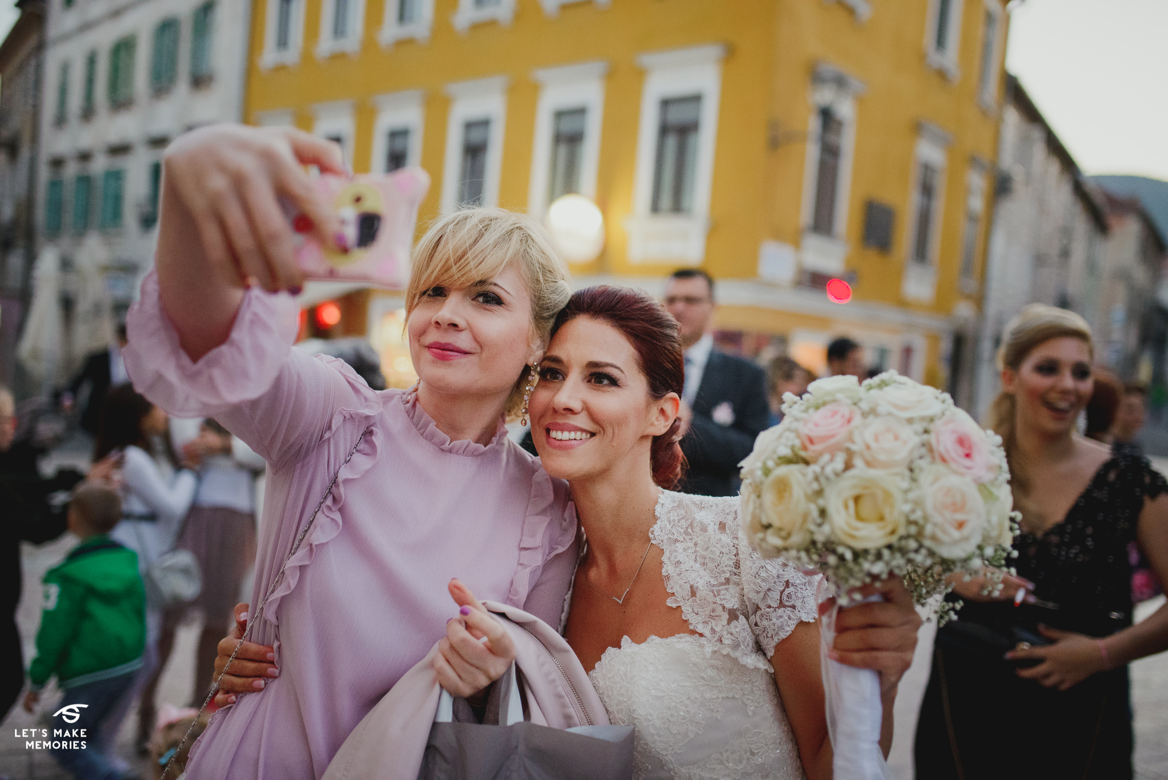 bride taking a selfie with a guest