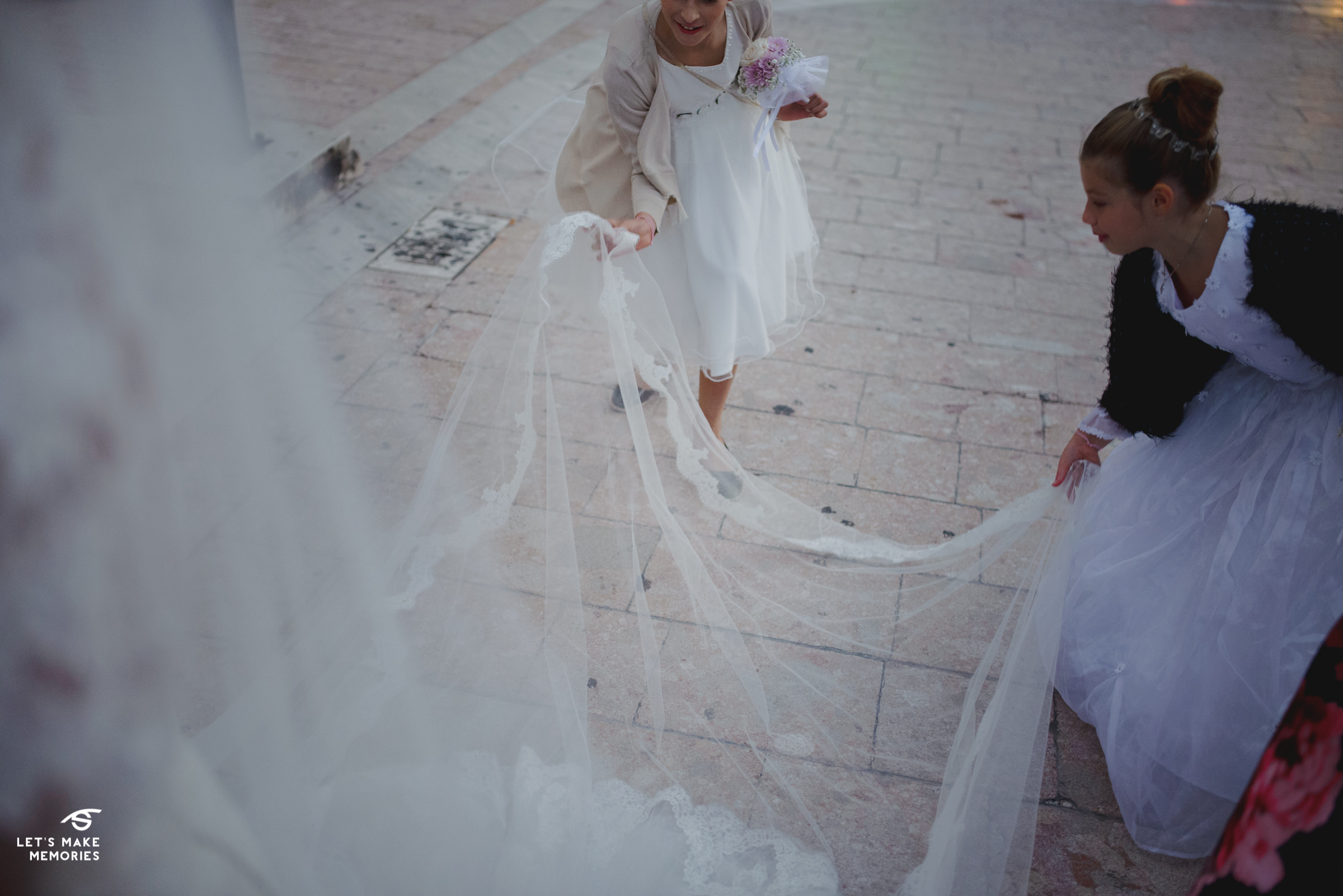 two little girls holding the veil