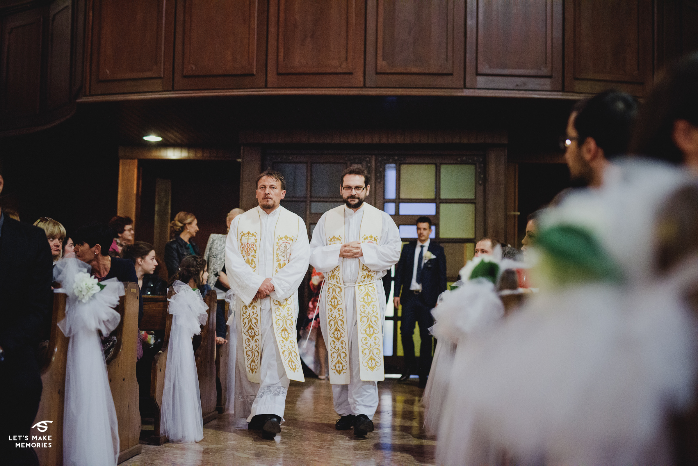 priests walking down the aisle