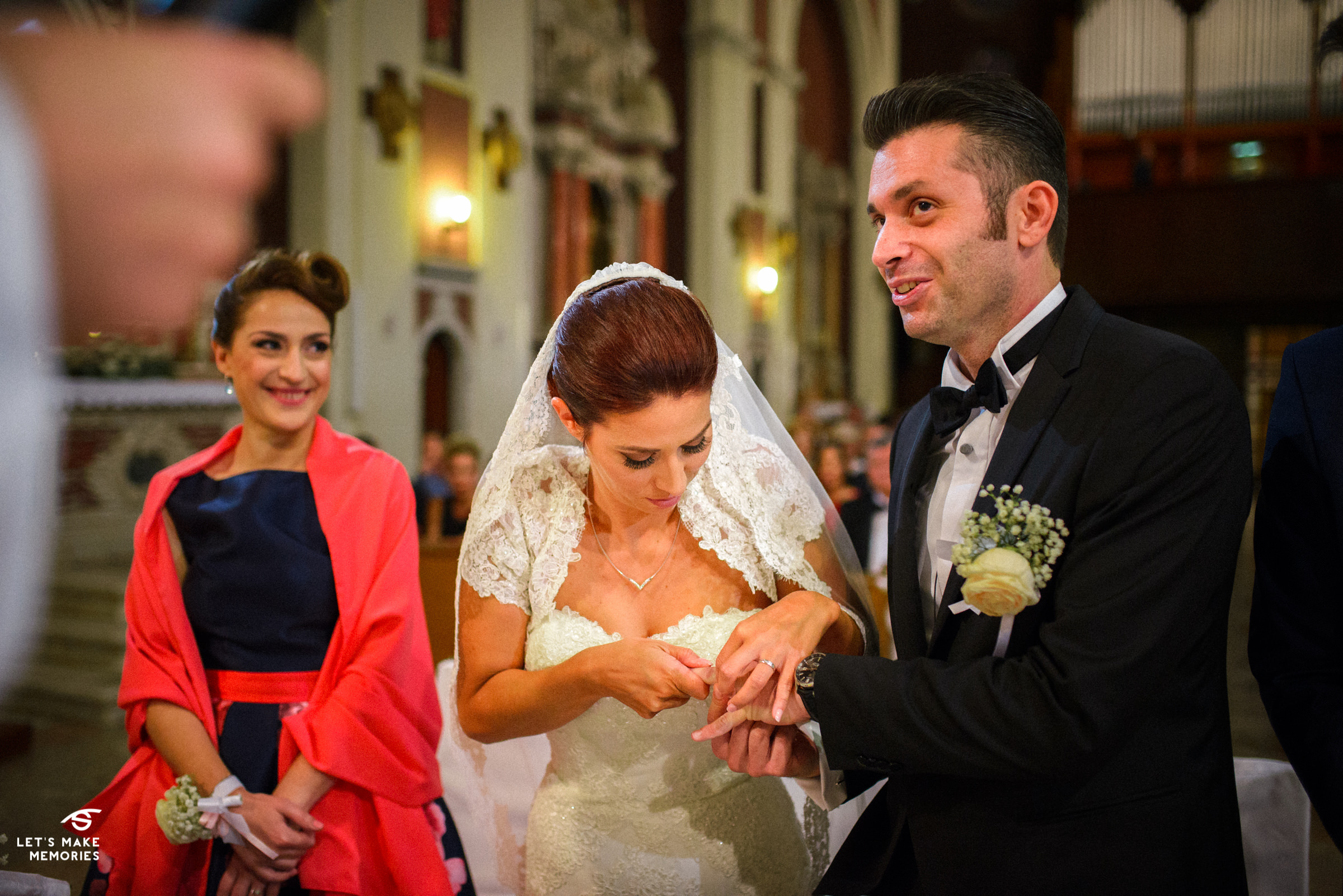 bride struggling to put on the wedding ring on grooms finger