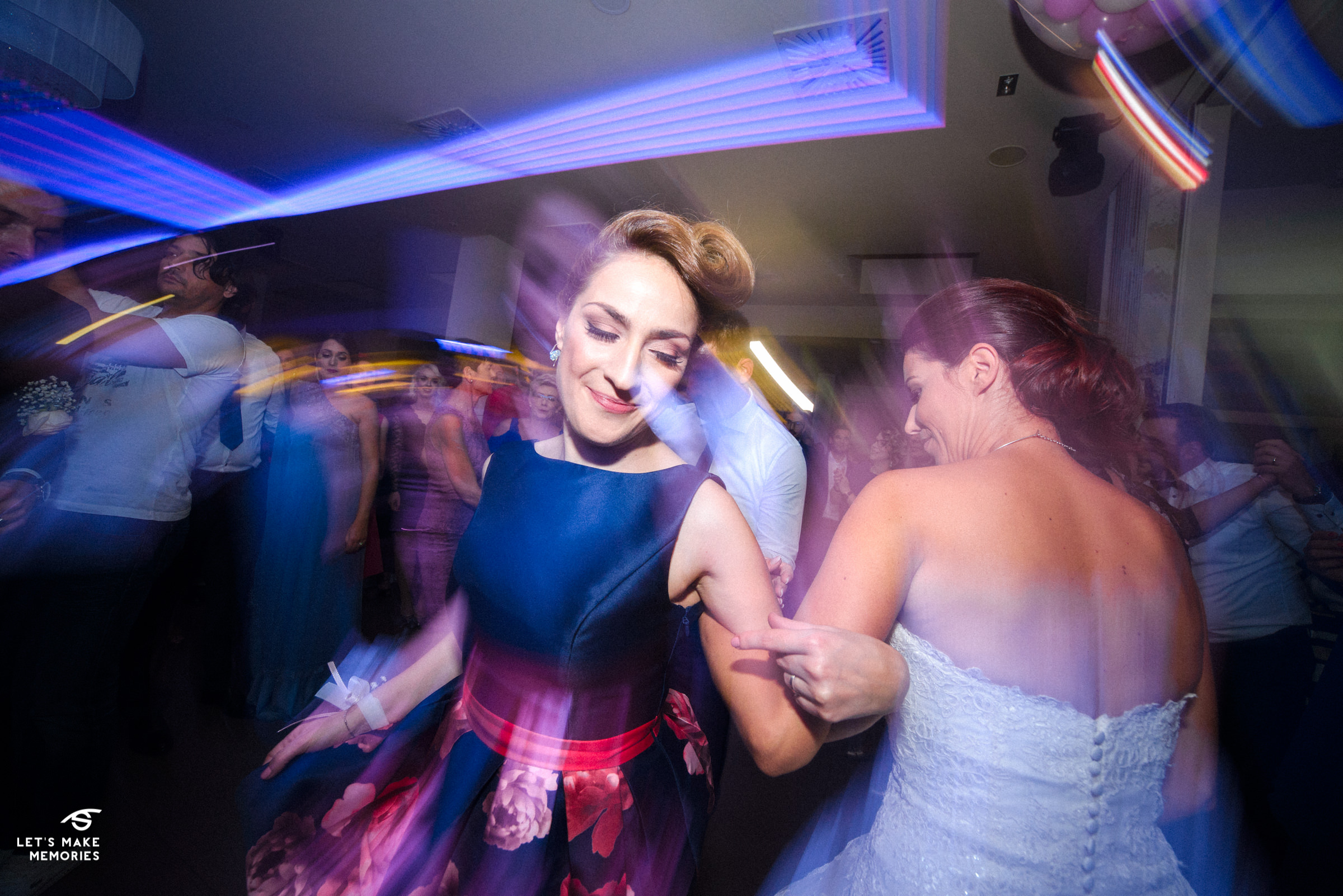 bride and her maid of honor dancing in circles