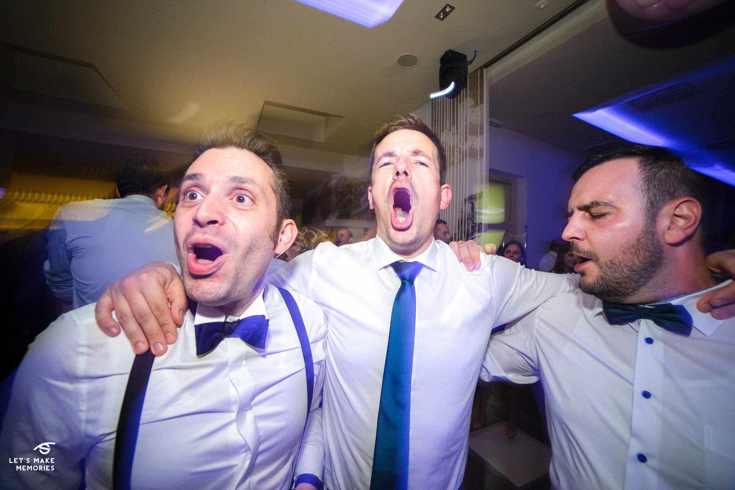 best man and groom singing song