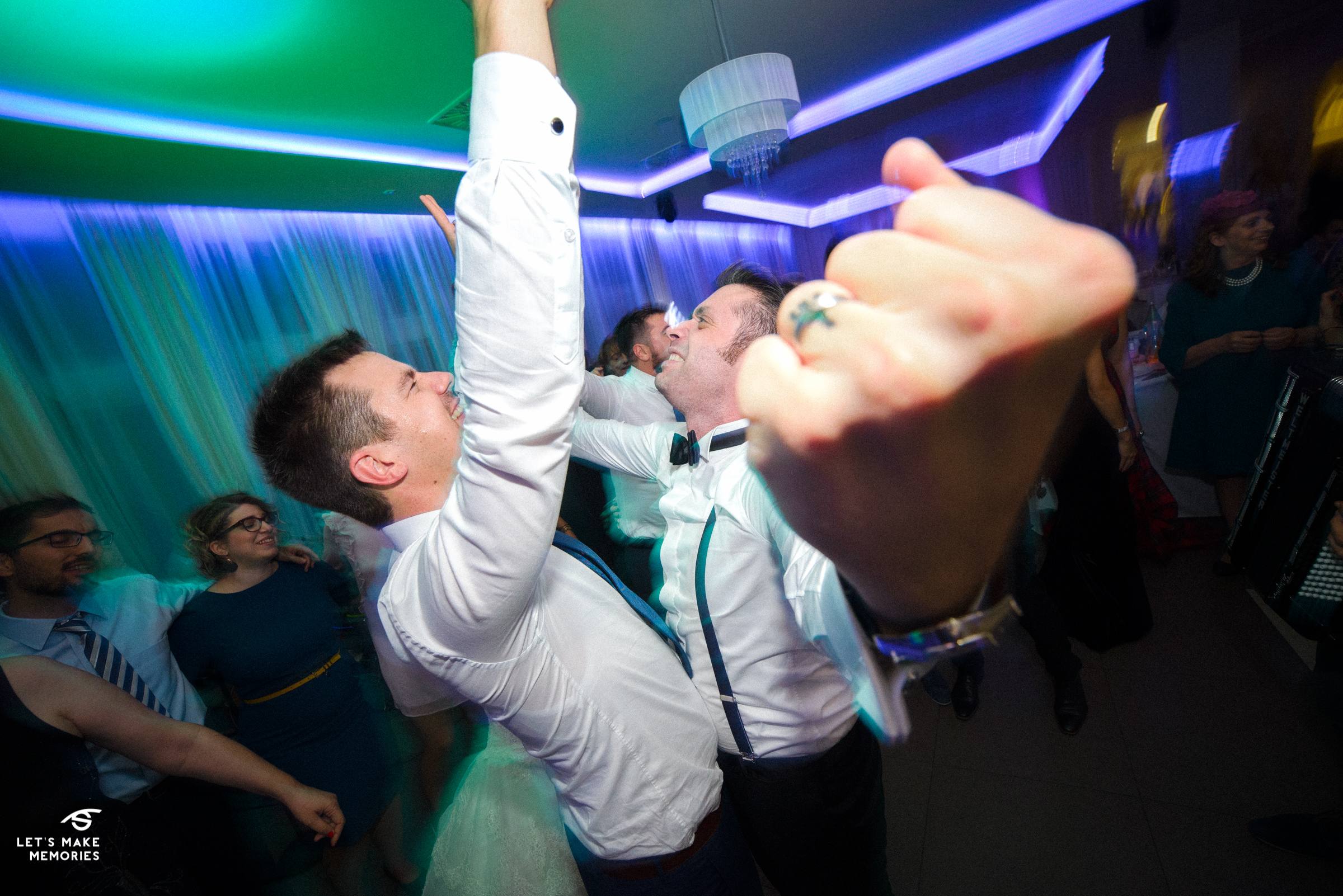 groom and his best man dancing to music