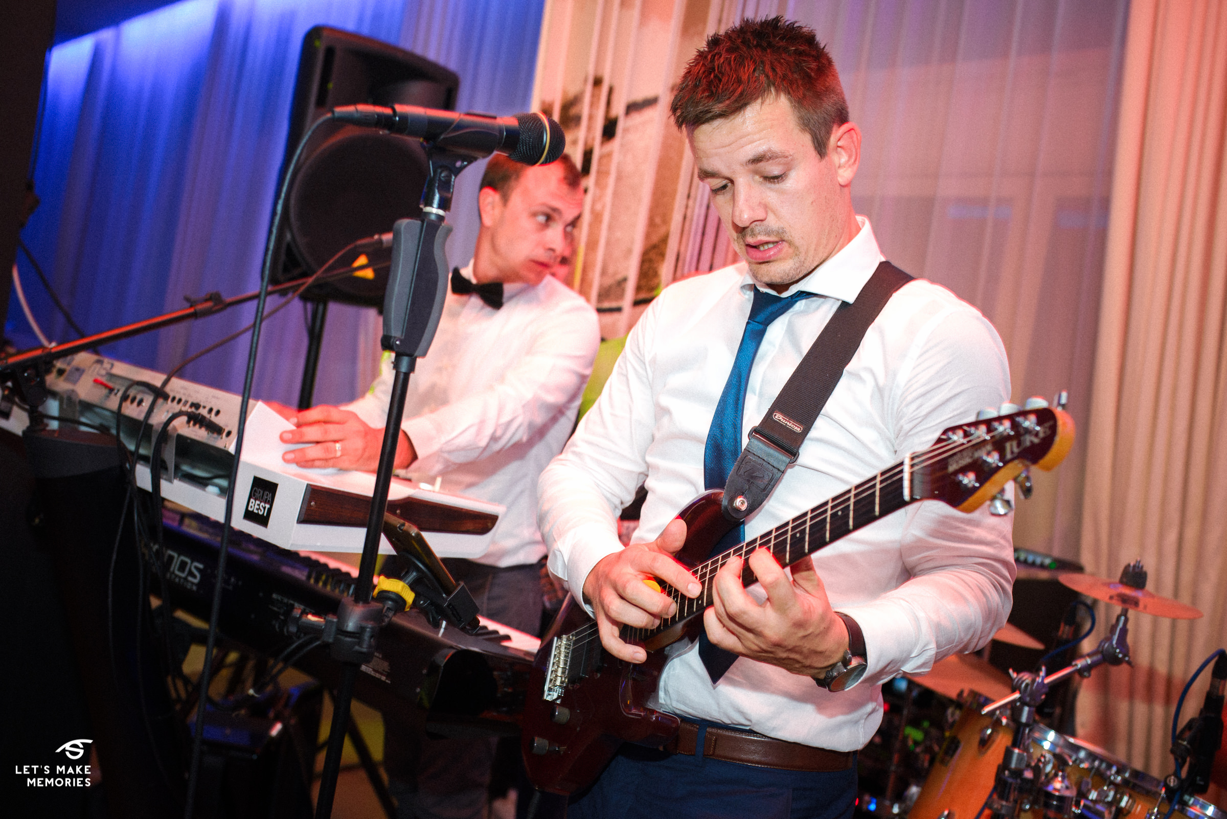 best man playing guitar in a wedding