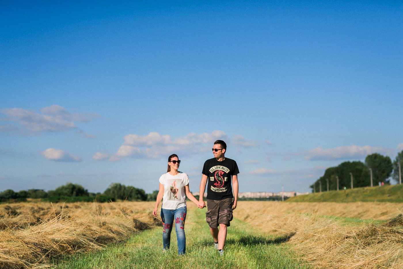 couple walking between freshly cut grass on Sava DAmp