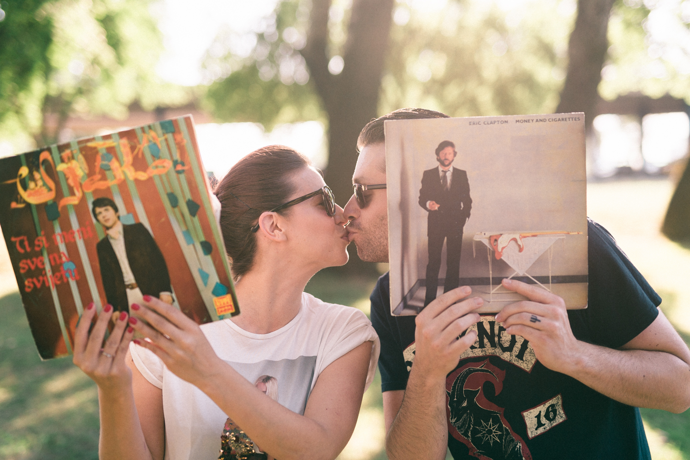 couple kissing behind turntable records