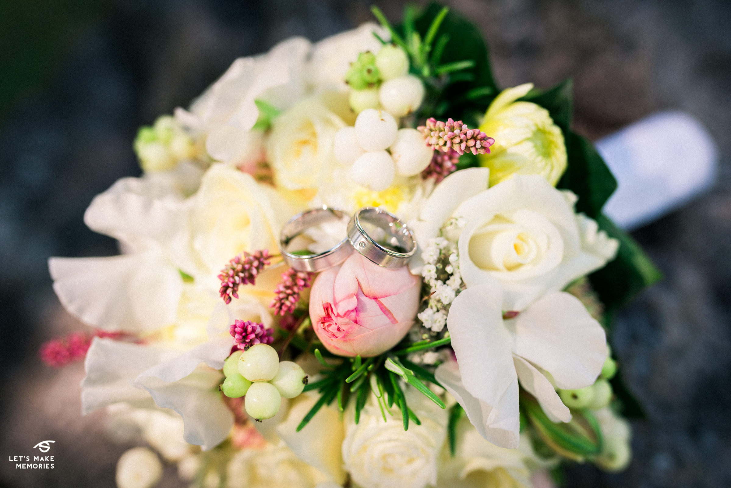 wedding rings placed on boquet