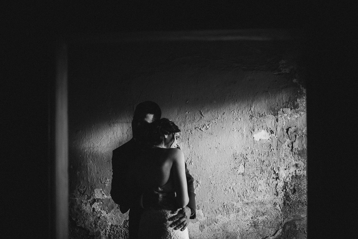 couple hugging in an abandoned house in Slavonija