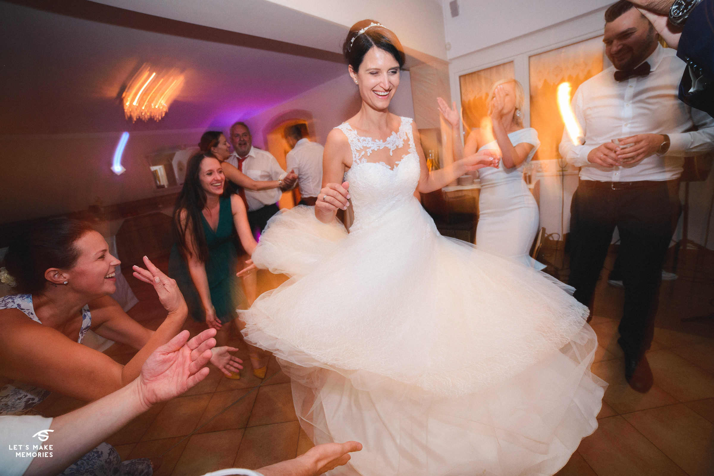 bride spinning around with her dress expanding