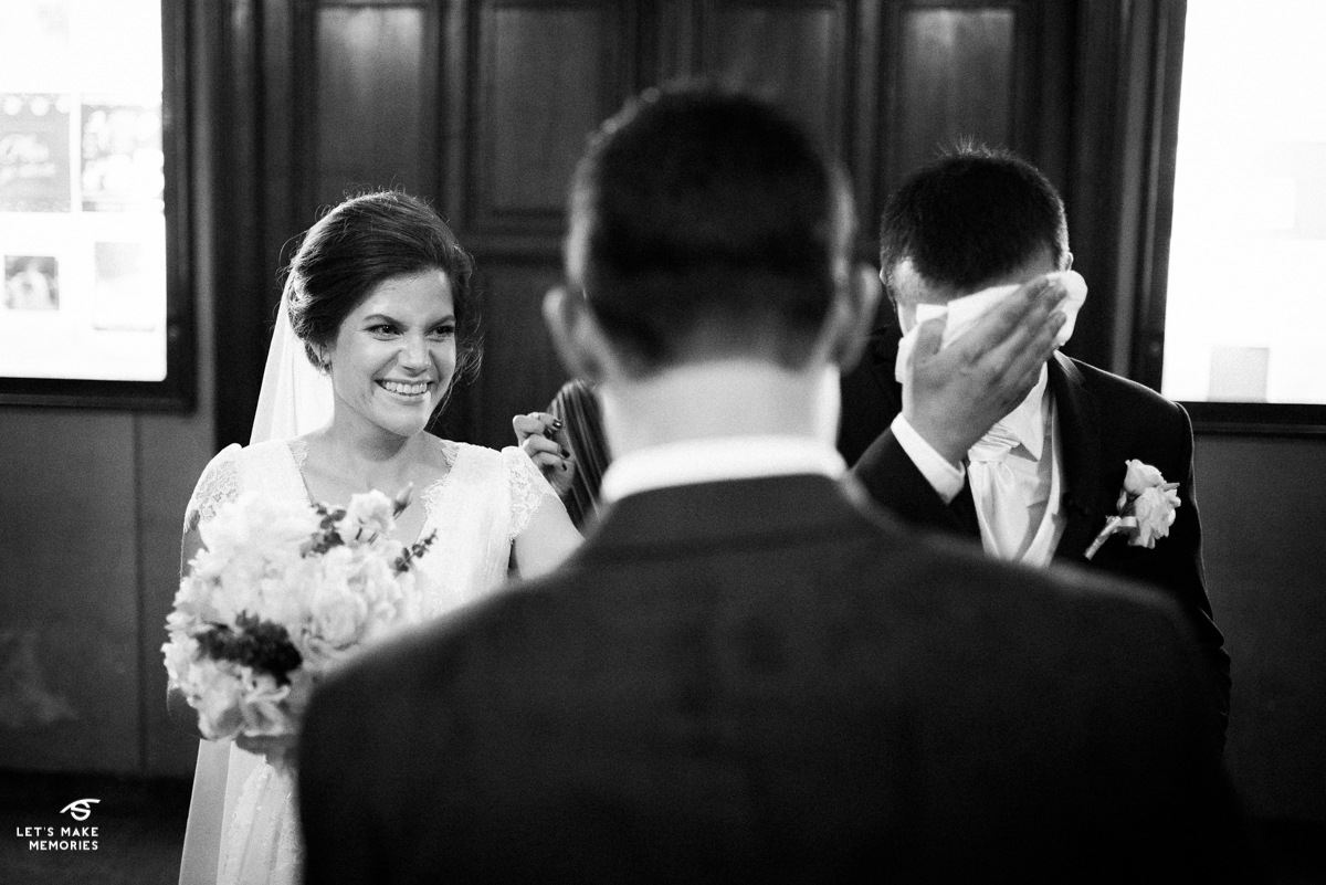 bride laughing and groom crying to the words spoken by his best man