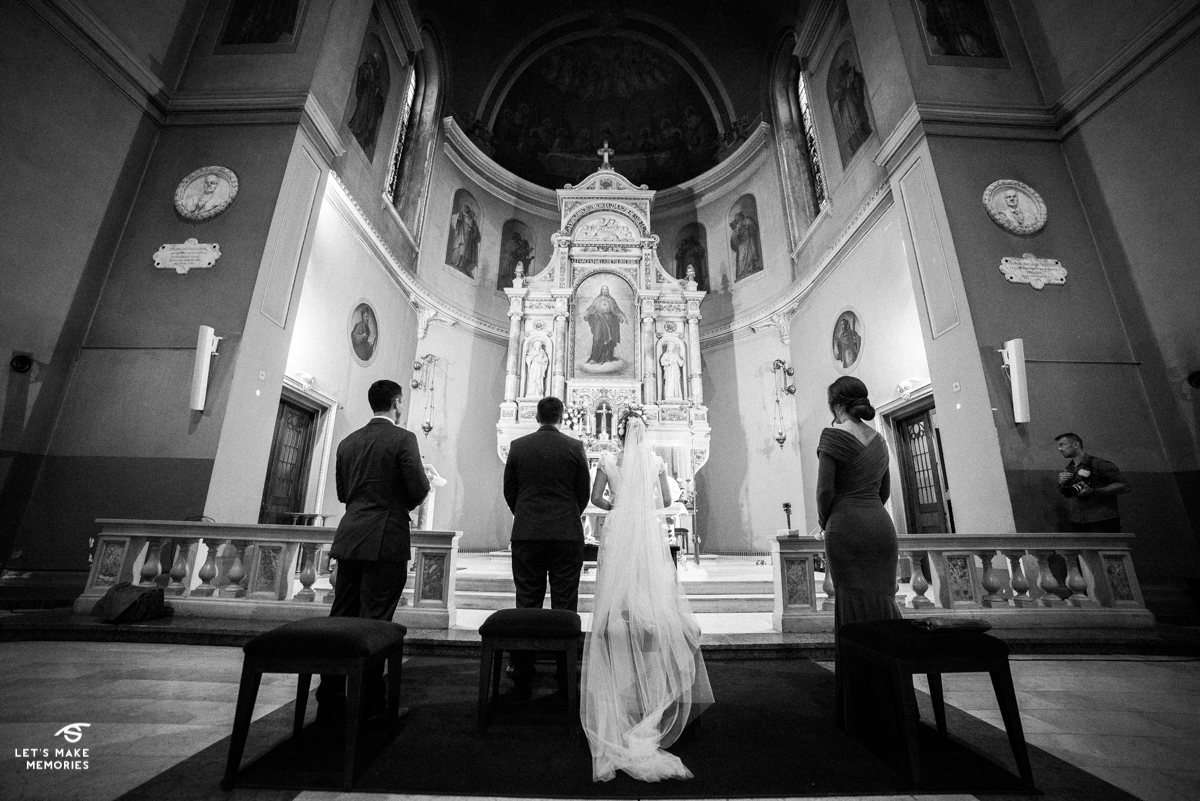bridal party in front of the altar