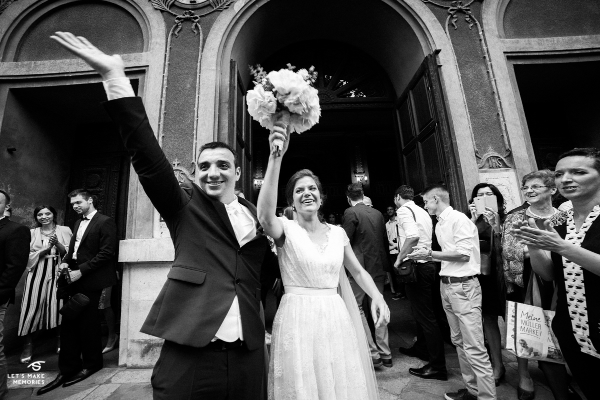 couple exiting church after they got married