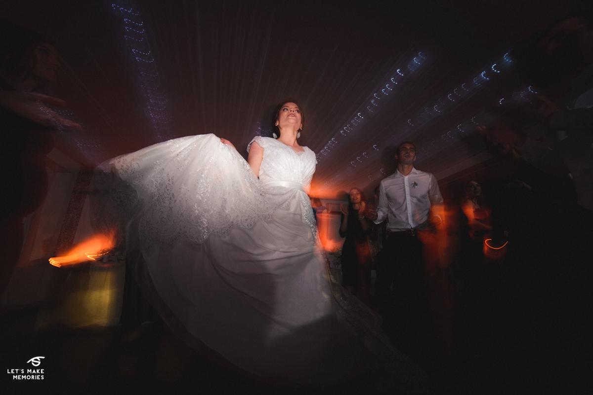 bride swiping her wedding dress around to the music
