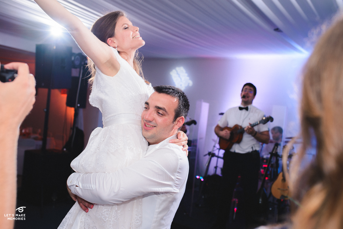 groom carrying the bride while she is dancing and singing to the song