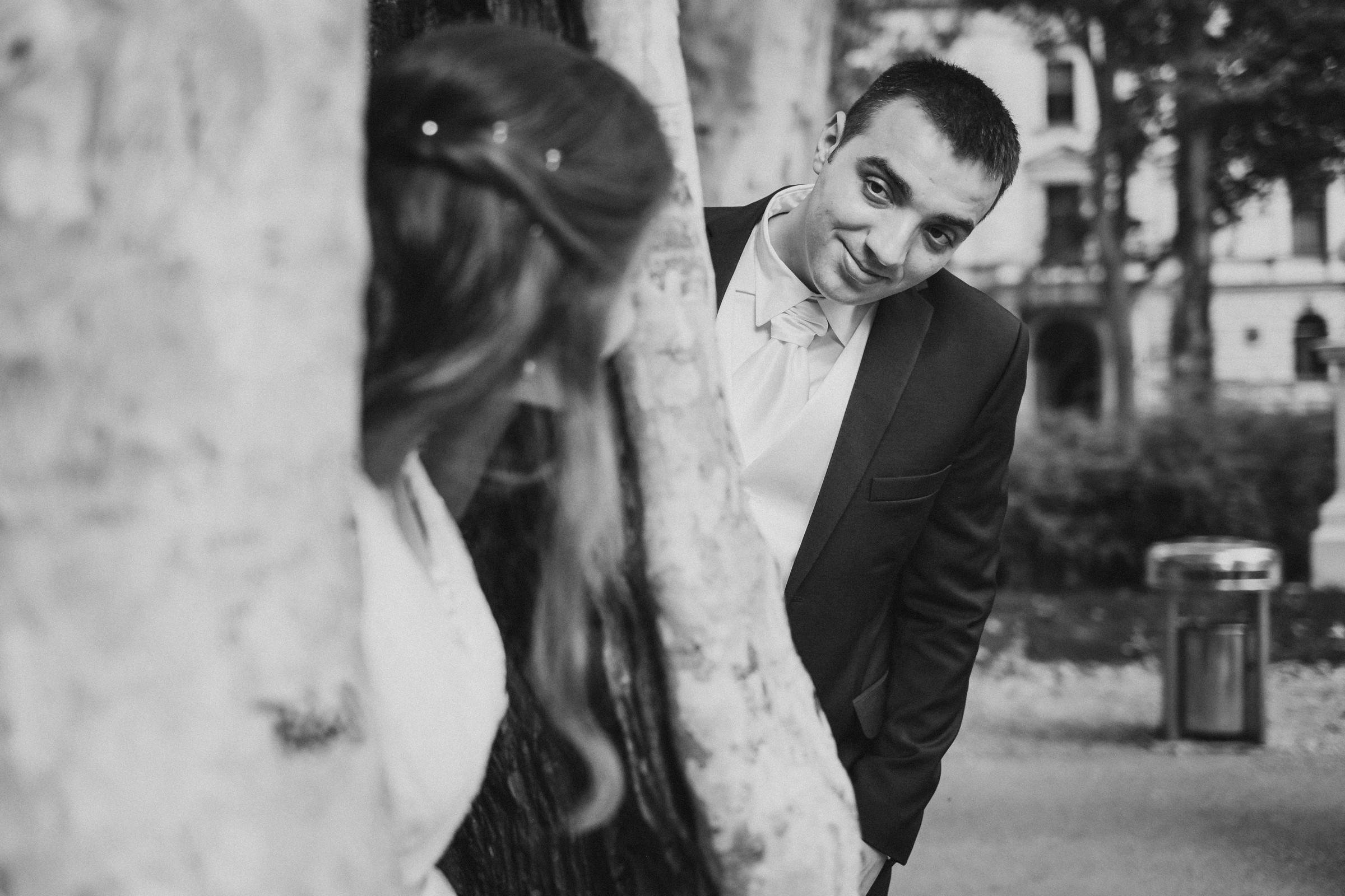 groom looking at the bride who is inside of the tree
