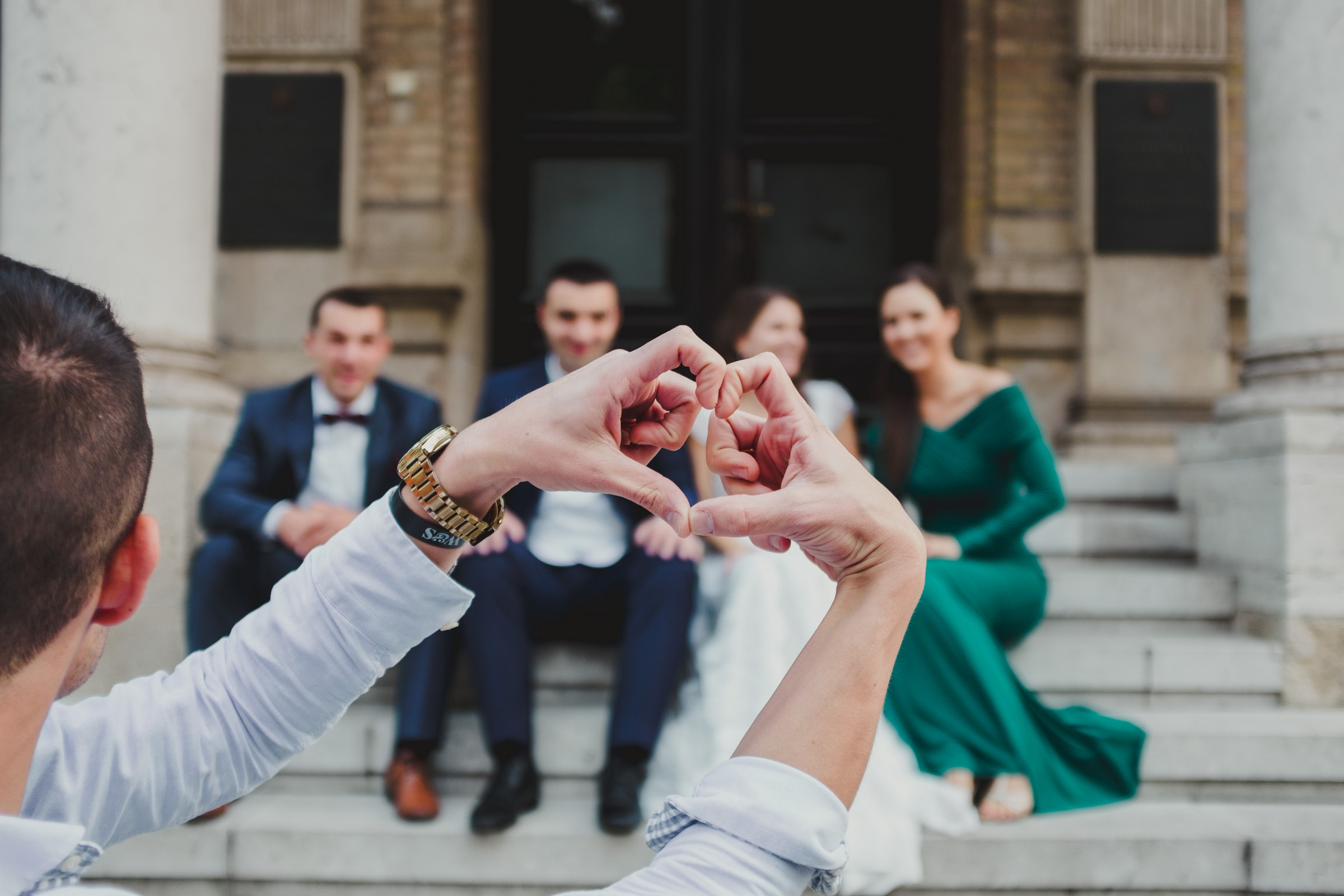 passer-by holds heart with his hands during the photo session