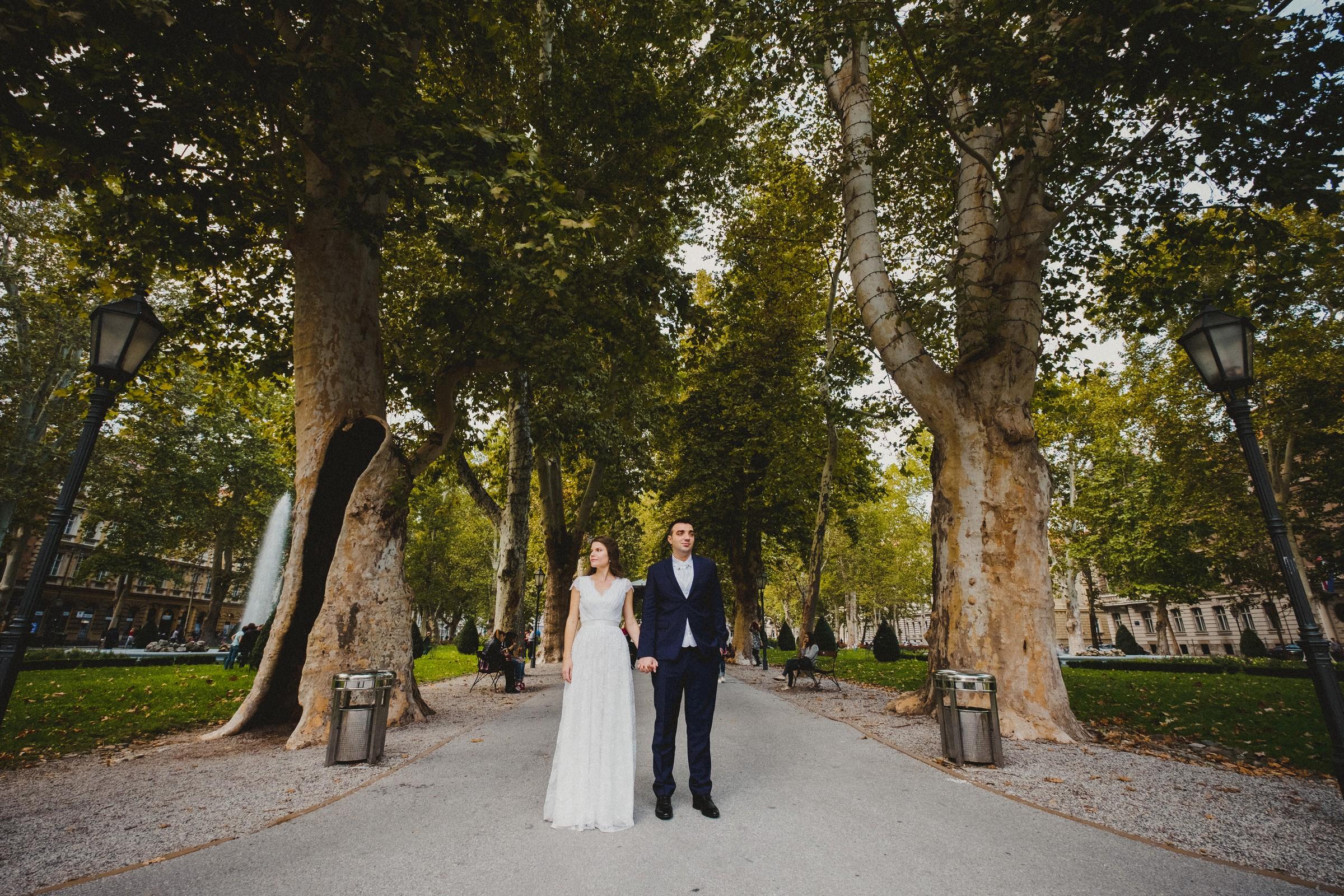 couple holding hands in zrinjevac park in zagreb, croatia