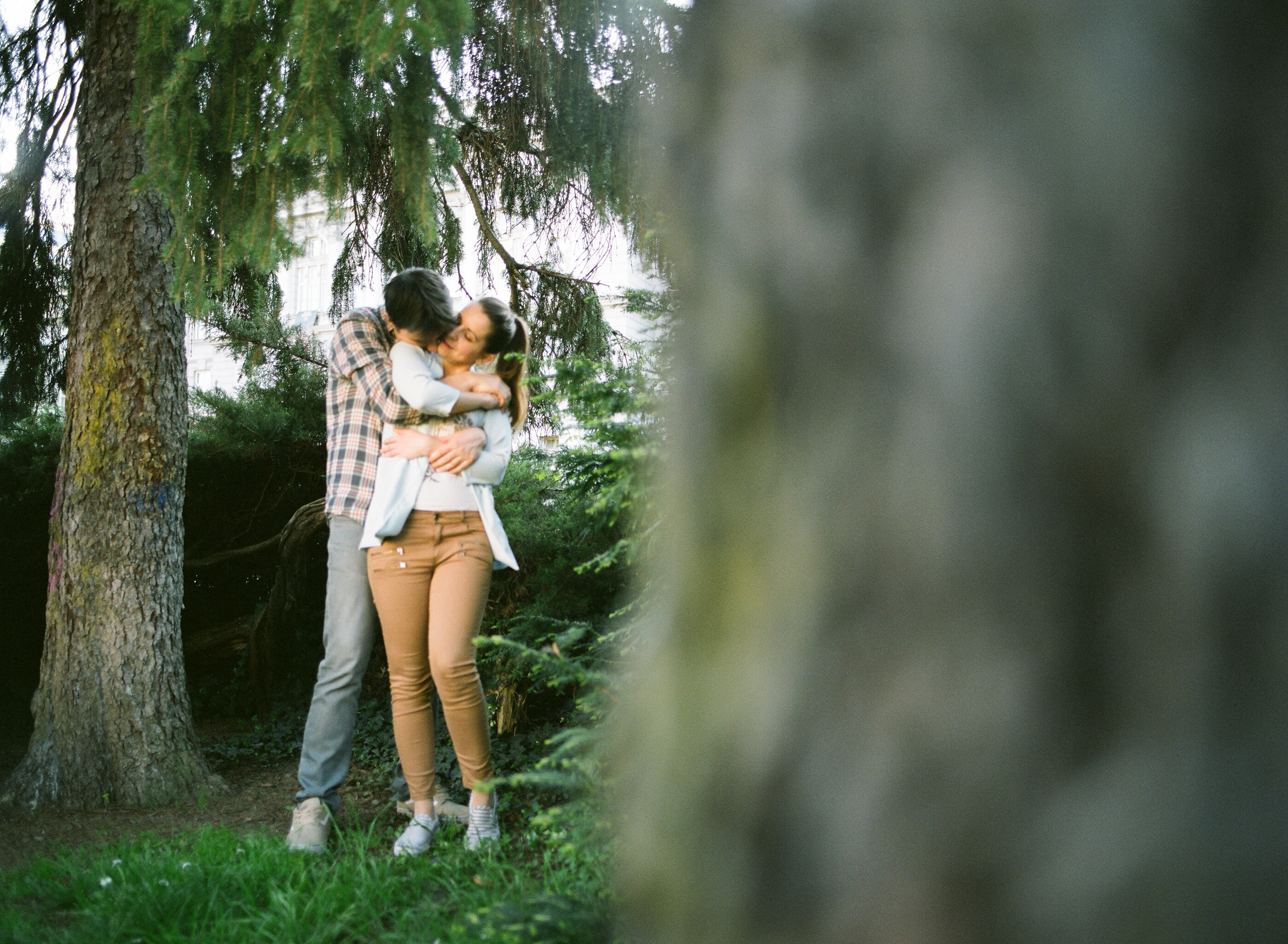 couple kissing in the woods. medium format film shot, mamiya 645 pro tl, sekor 45mm f2.8