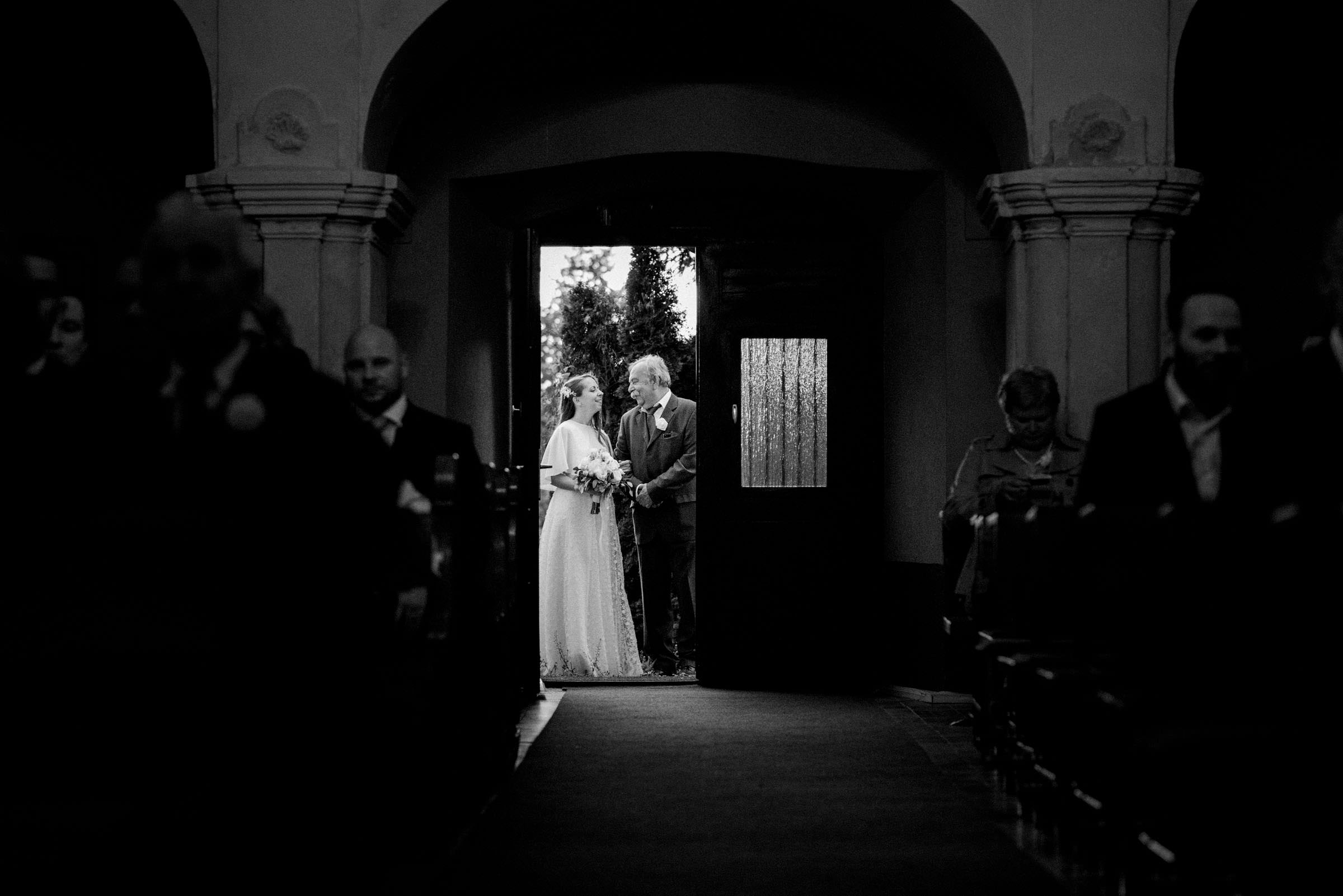 bride and her father sharing a moment outside the church before ceremony