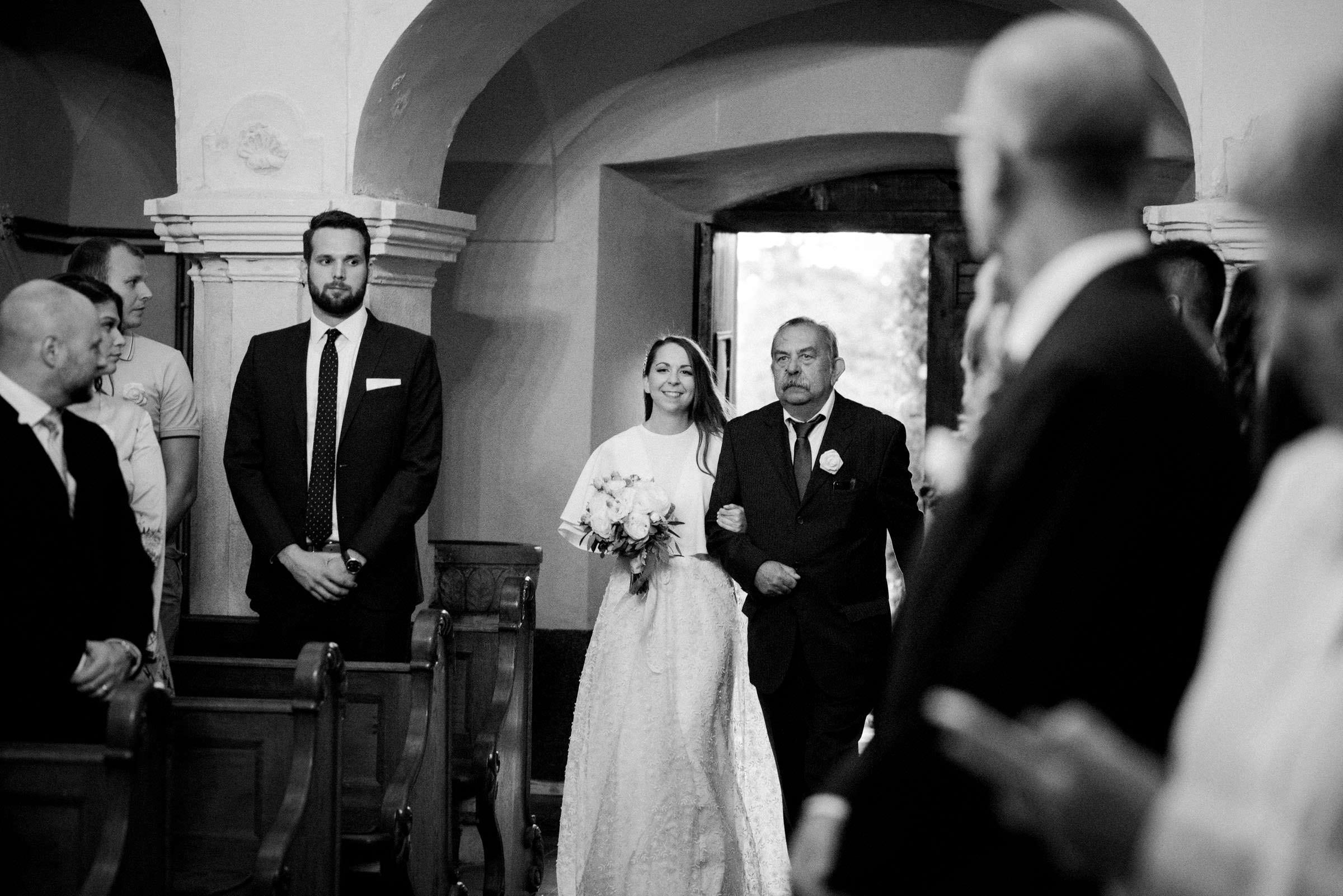 bride and her father walking down the aisle