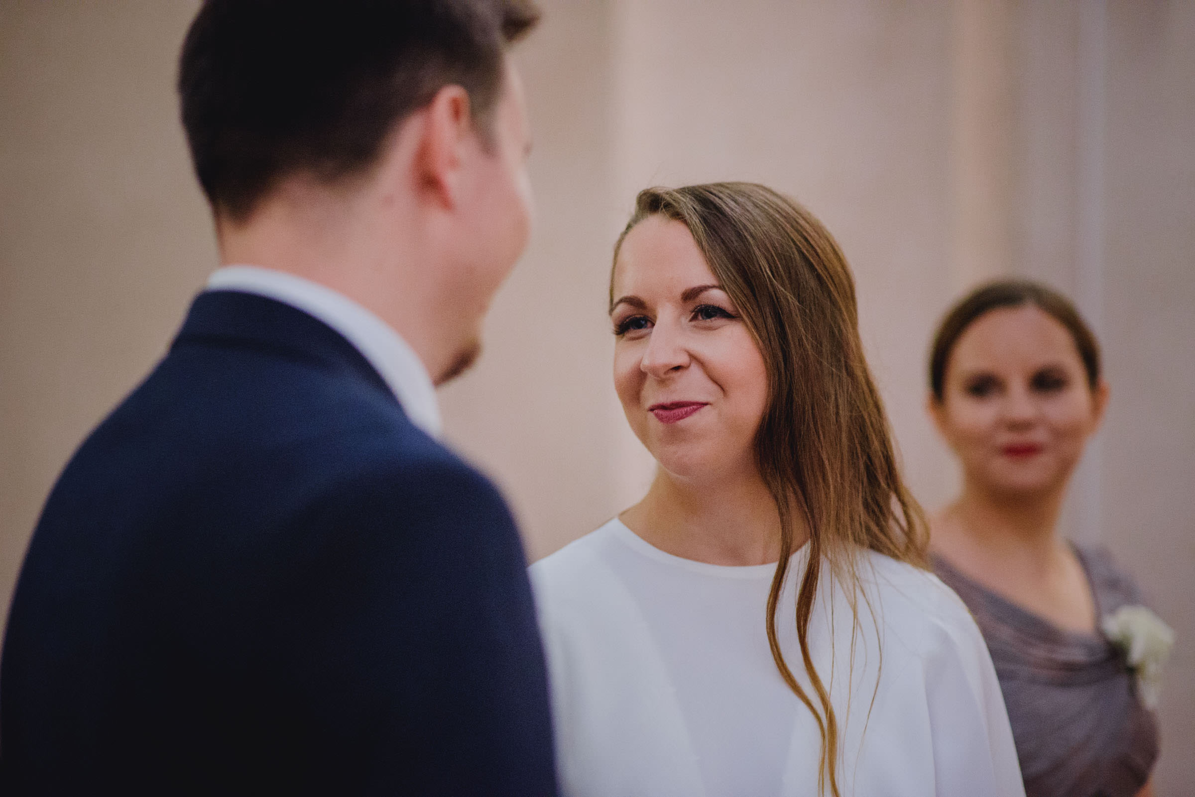bride looking and smiling at groom