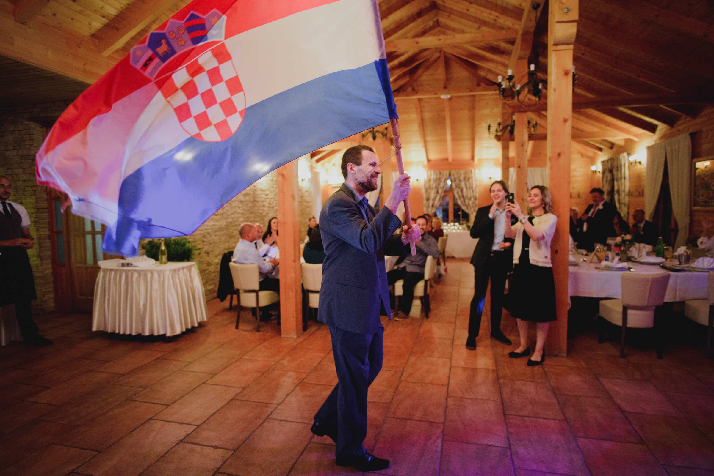 standard-bearer entering the restaurant with a flag