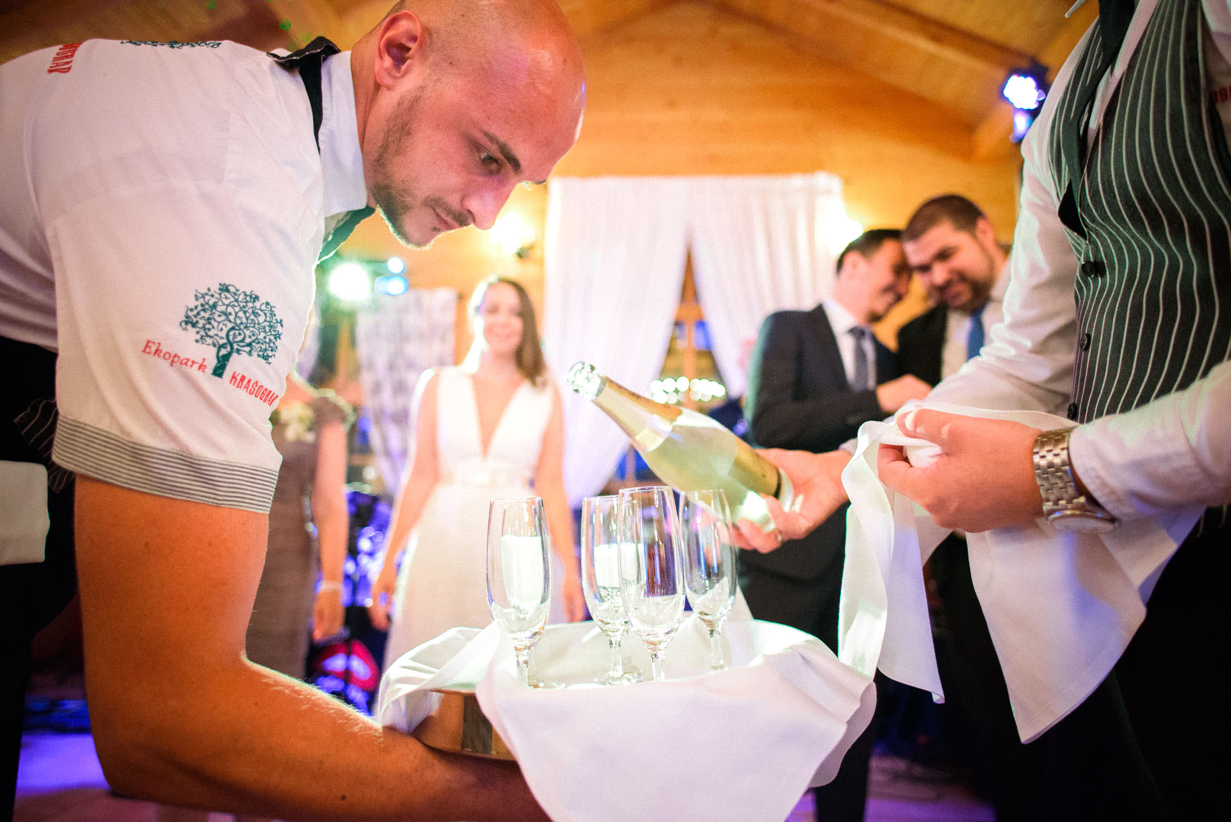 waiters pouring champagne