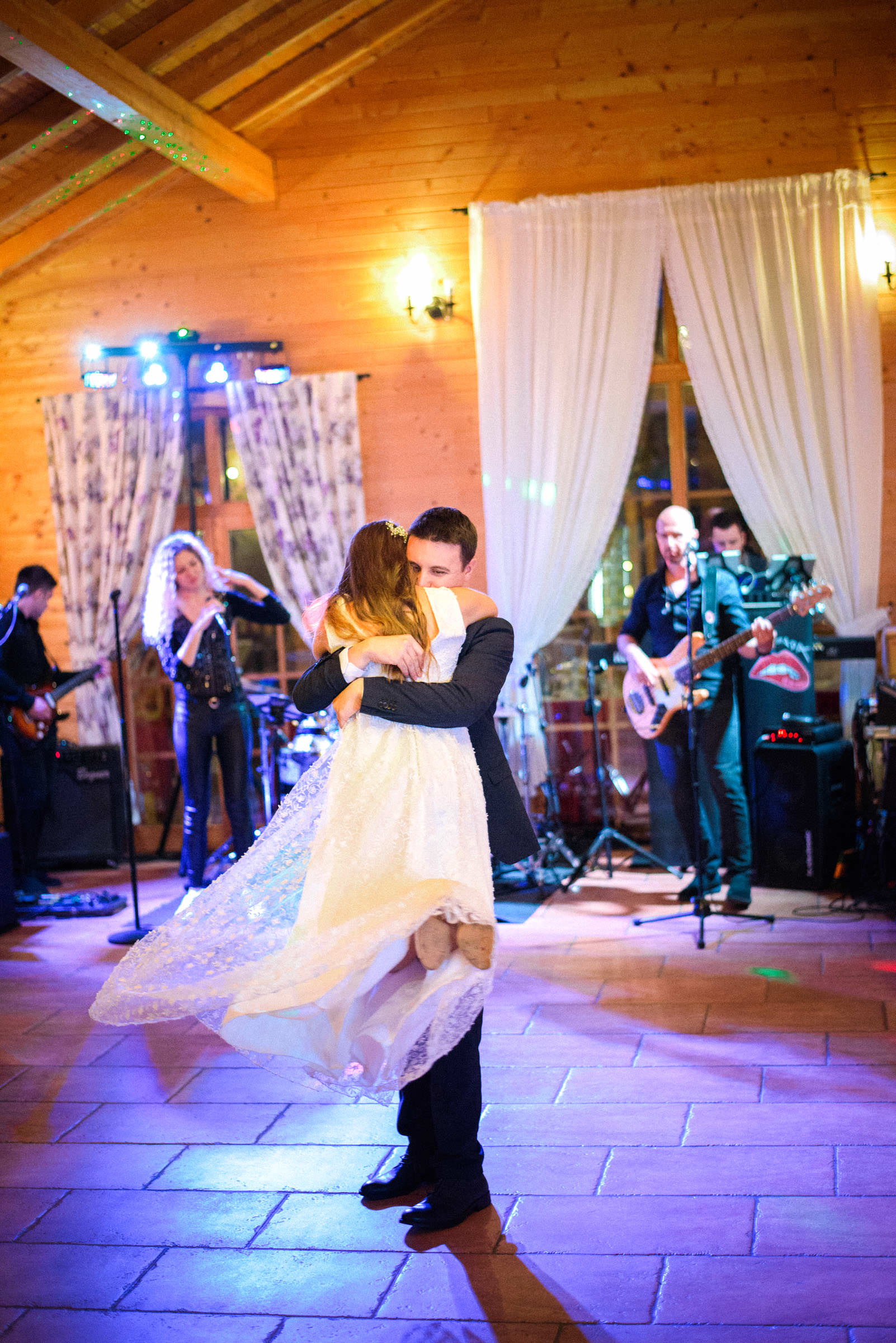 first dance, groom carrying bride