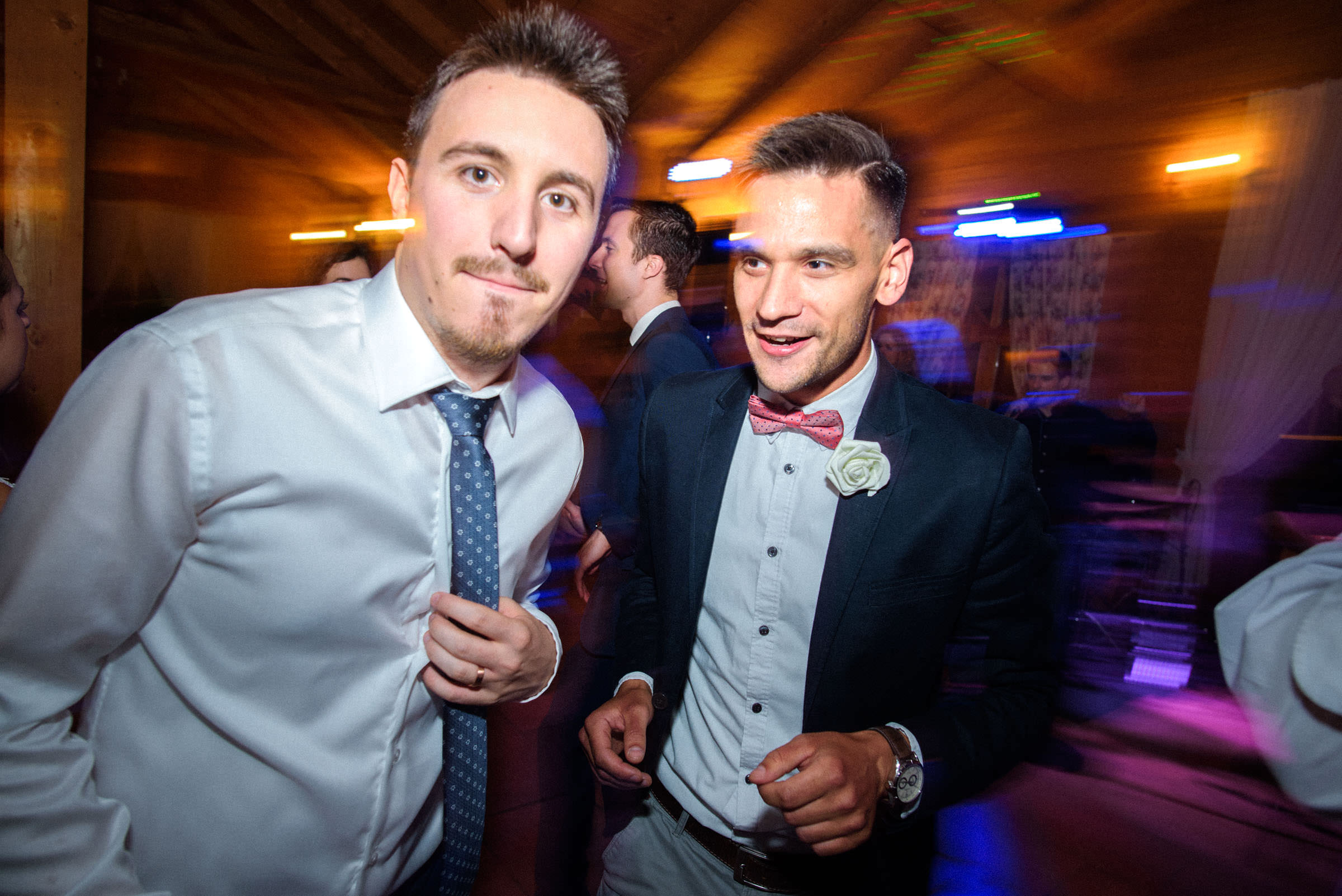 groom and his friend dancing to the music