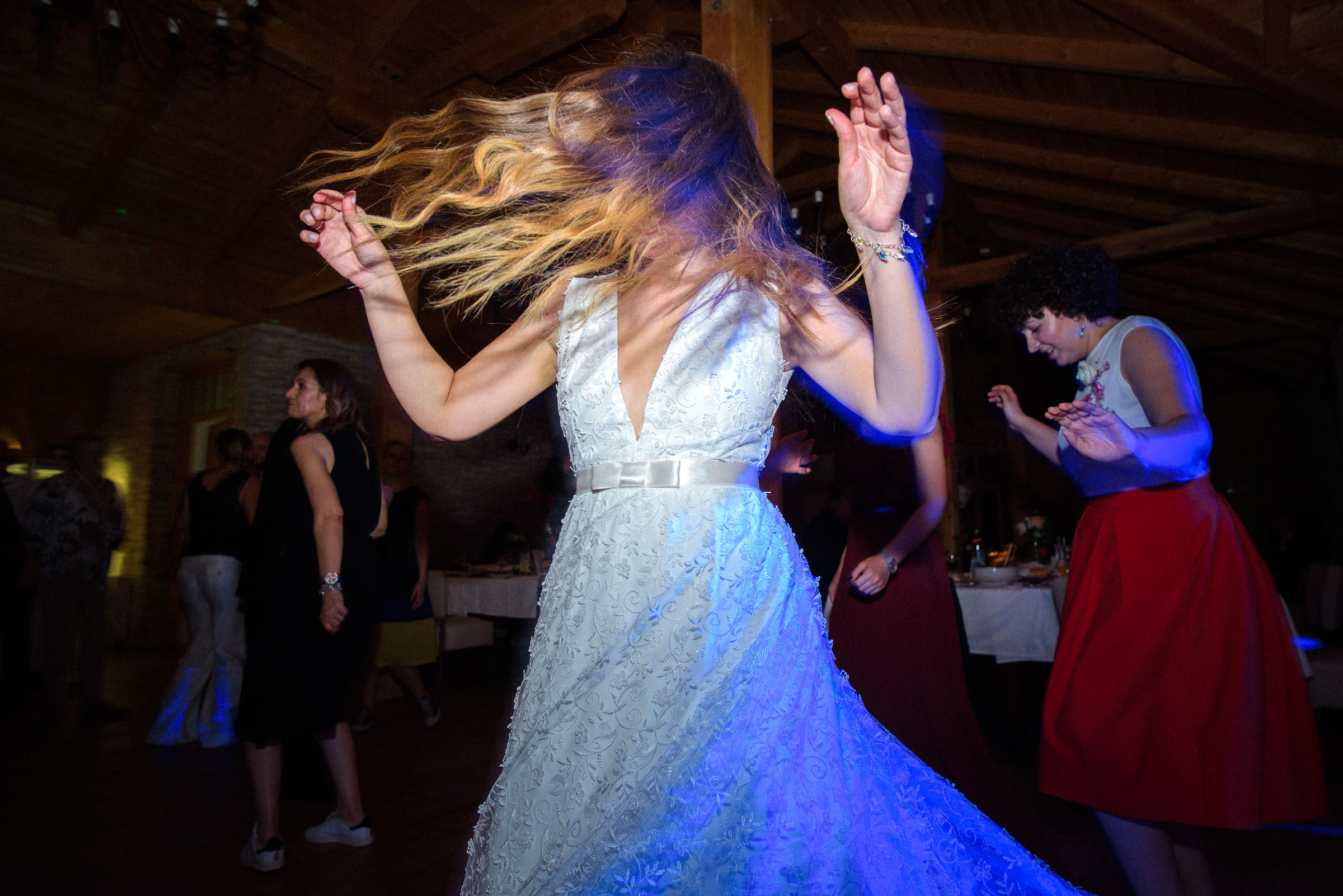 bride dancing wildly to the music and her hair is flying all around
