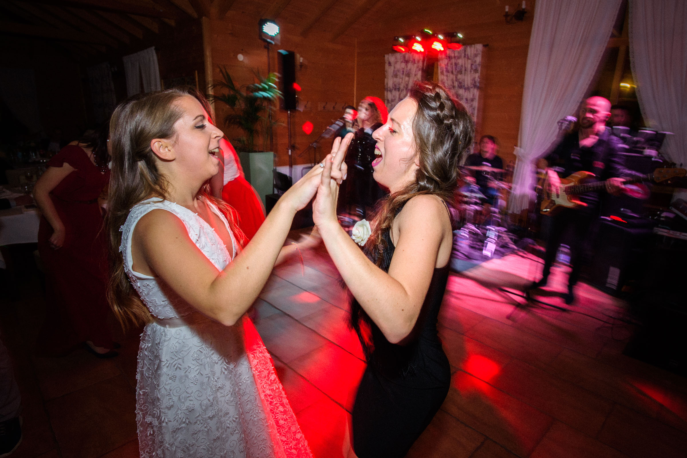 bride and her best friend dancing