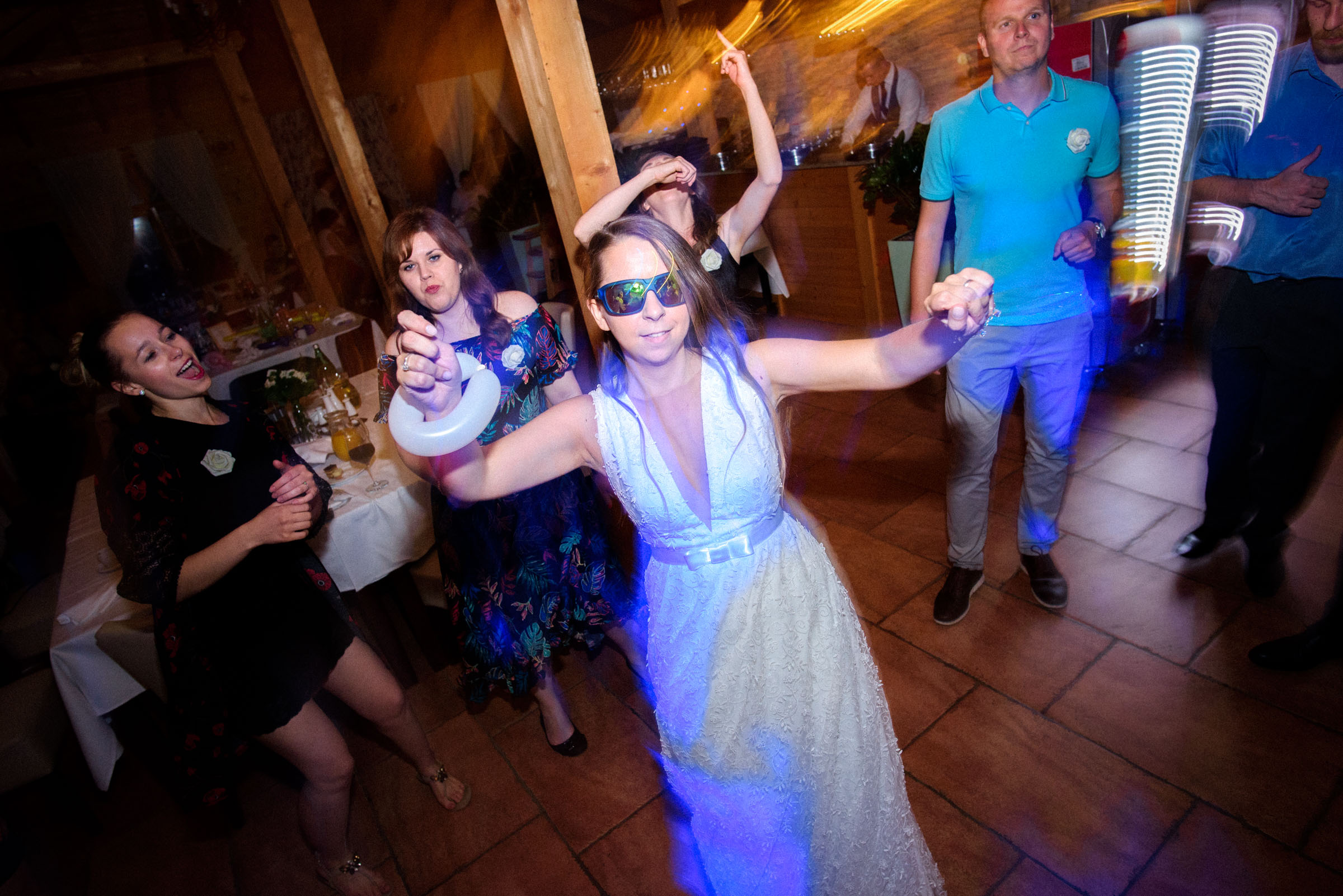 bride dancing with crazy glasses