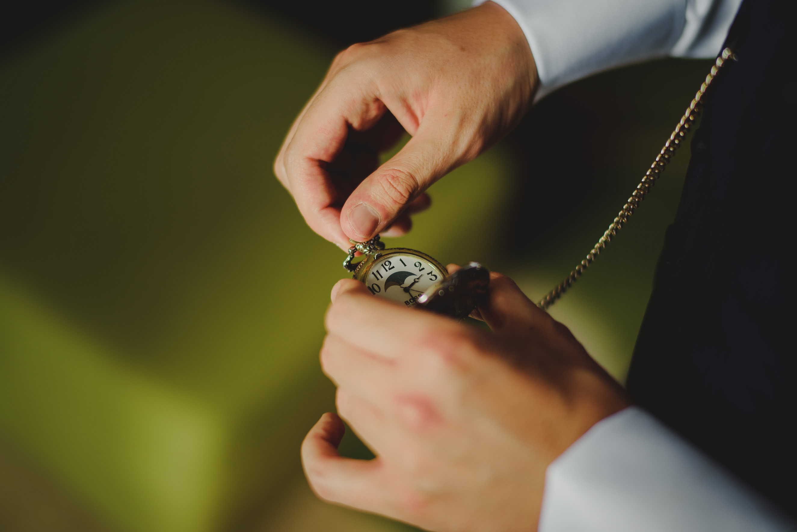 groom tuning his pocket watch