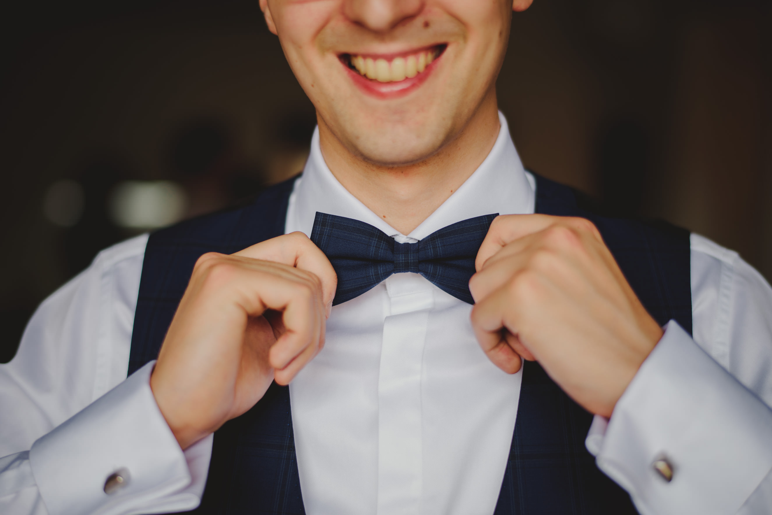 groom fixing his bowtie