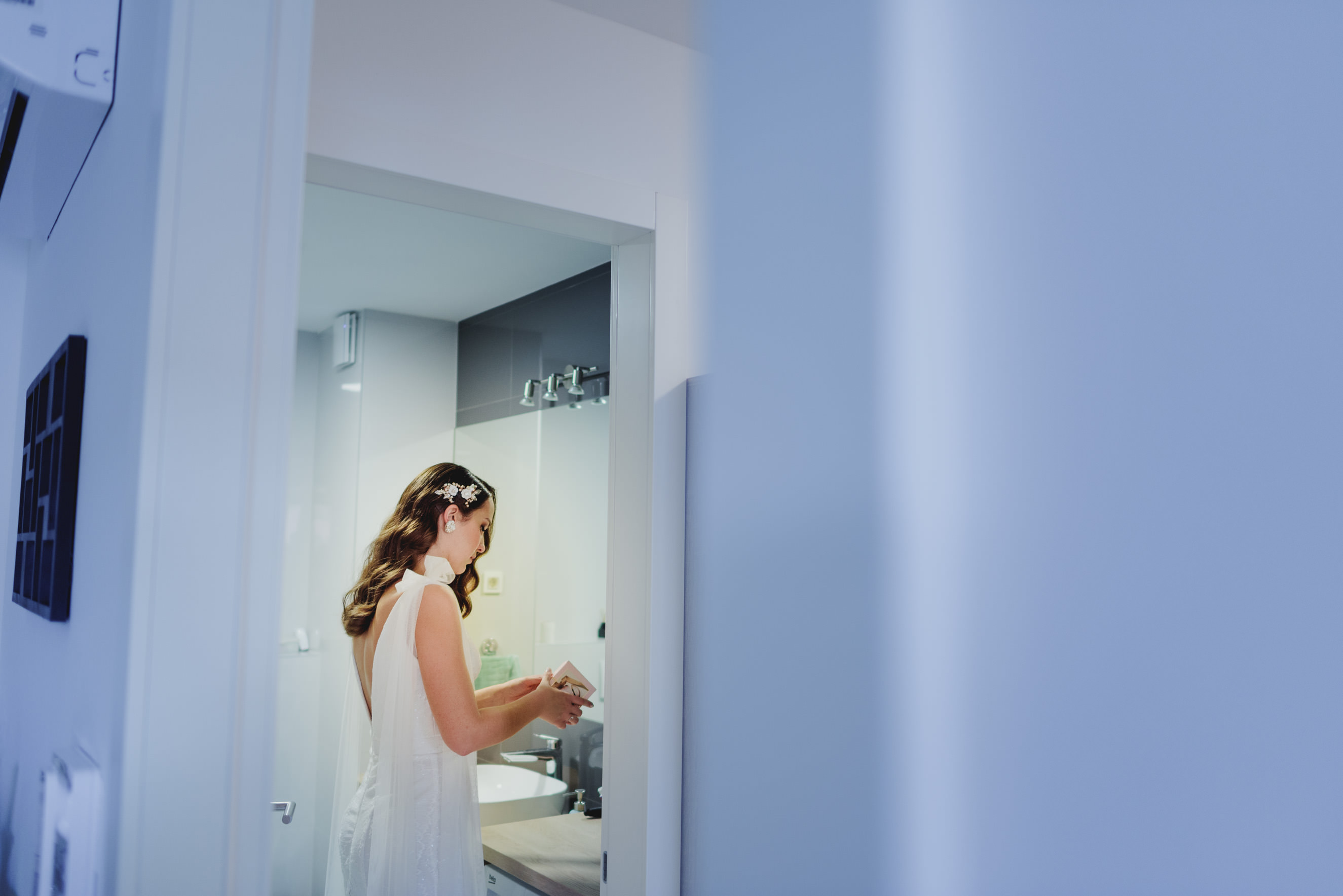 bride fixing her makeup in the bathroom