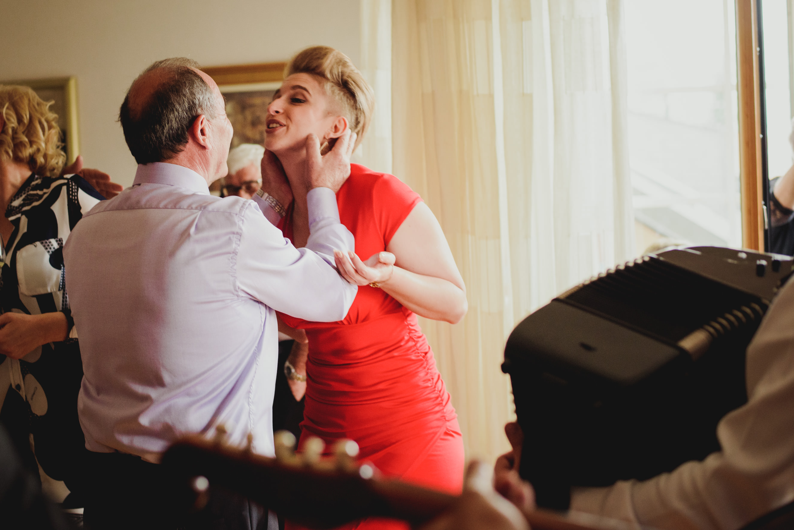 father and sister of the groom singing to the music and enjoying private time during the day