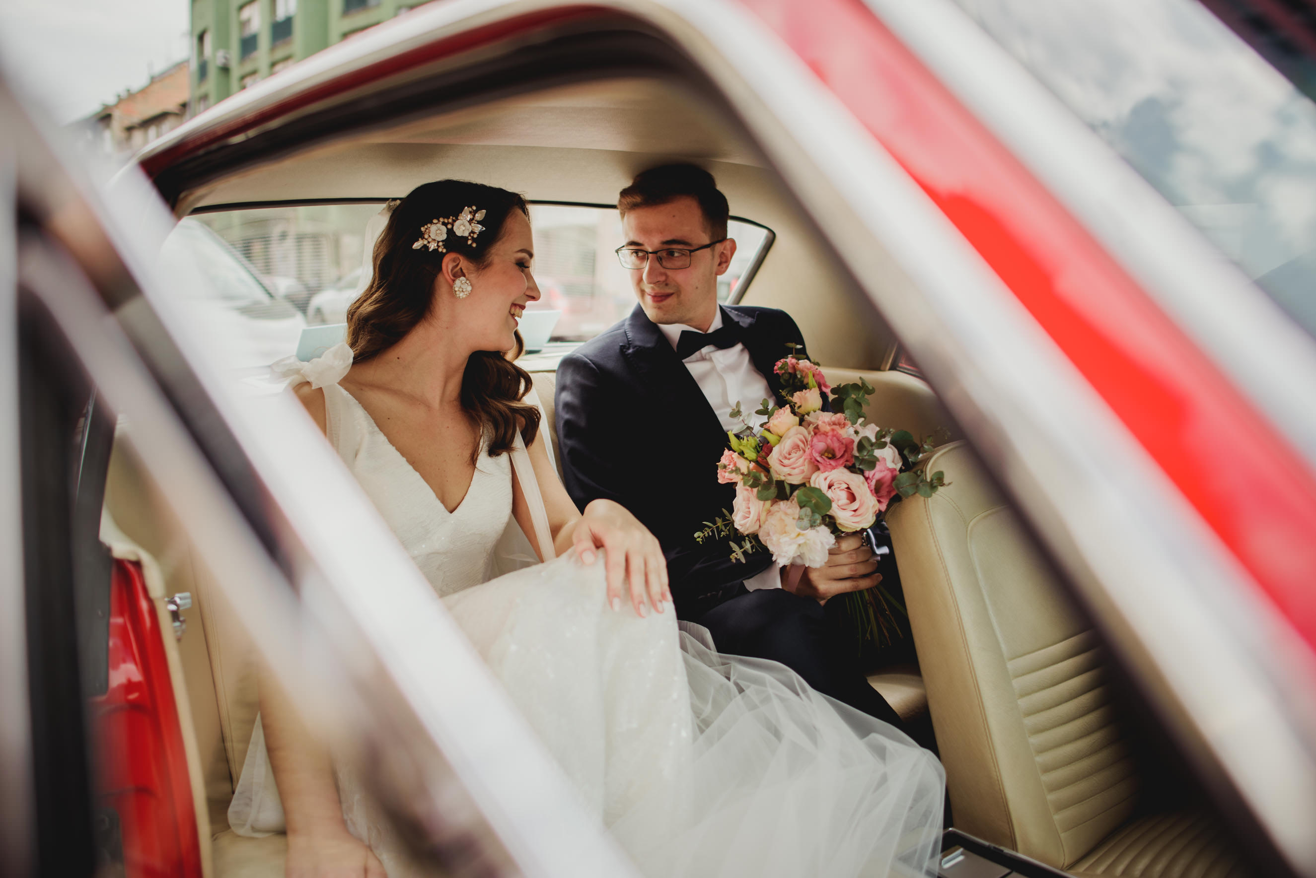 bride and groom holding hands and talking in rented Ford Mustang '67