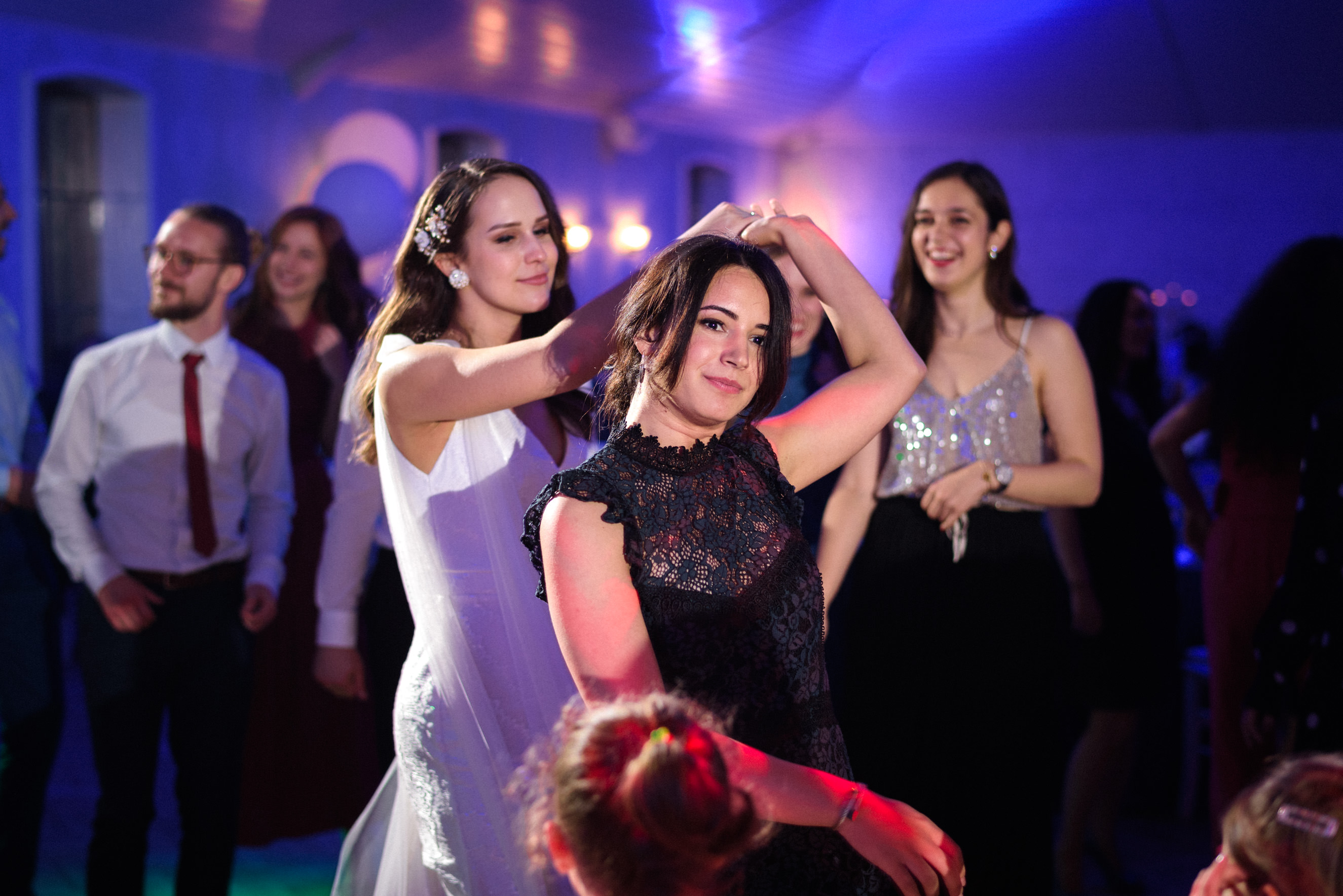 bride and maid of honour dancing to the music