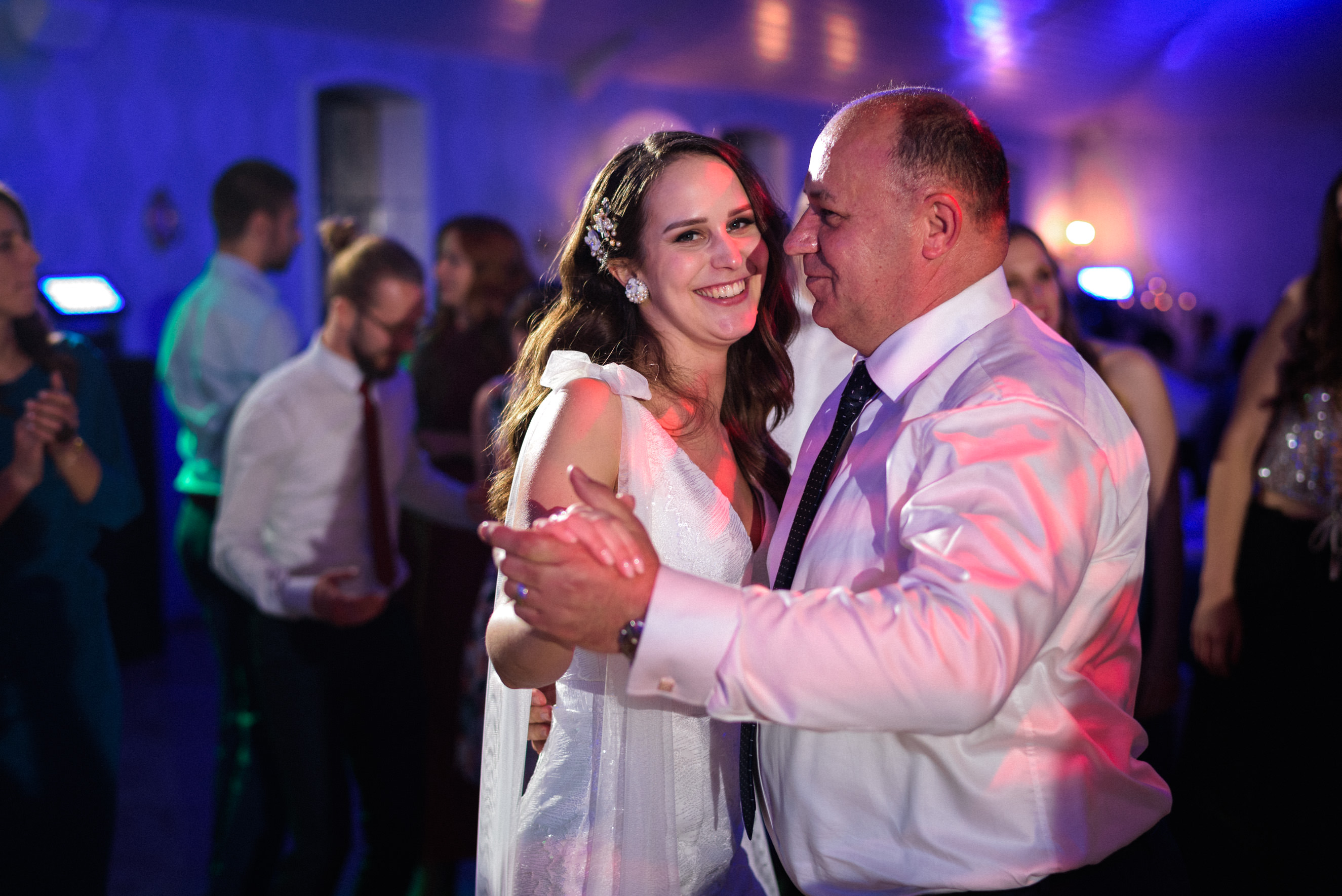 bride and her father dancing to the music