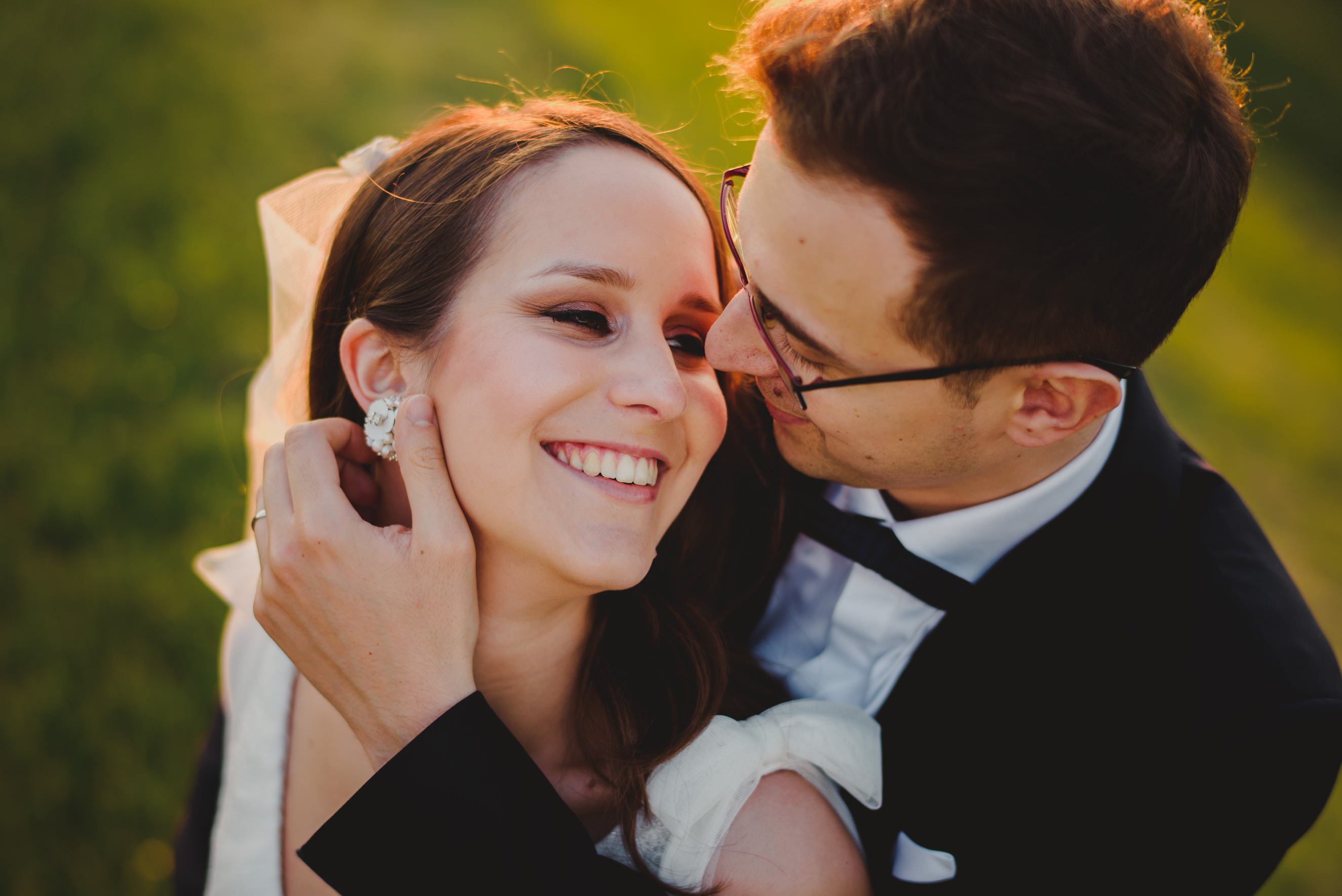 romantic hug between bride and her groom in the middle of the field