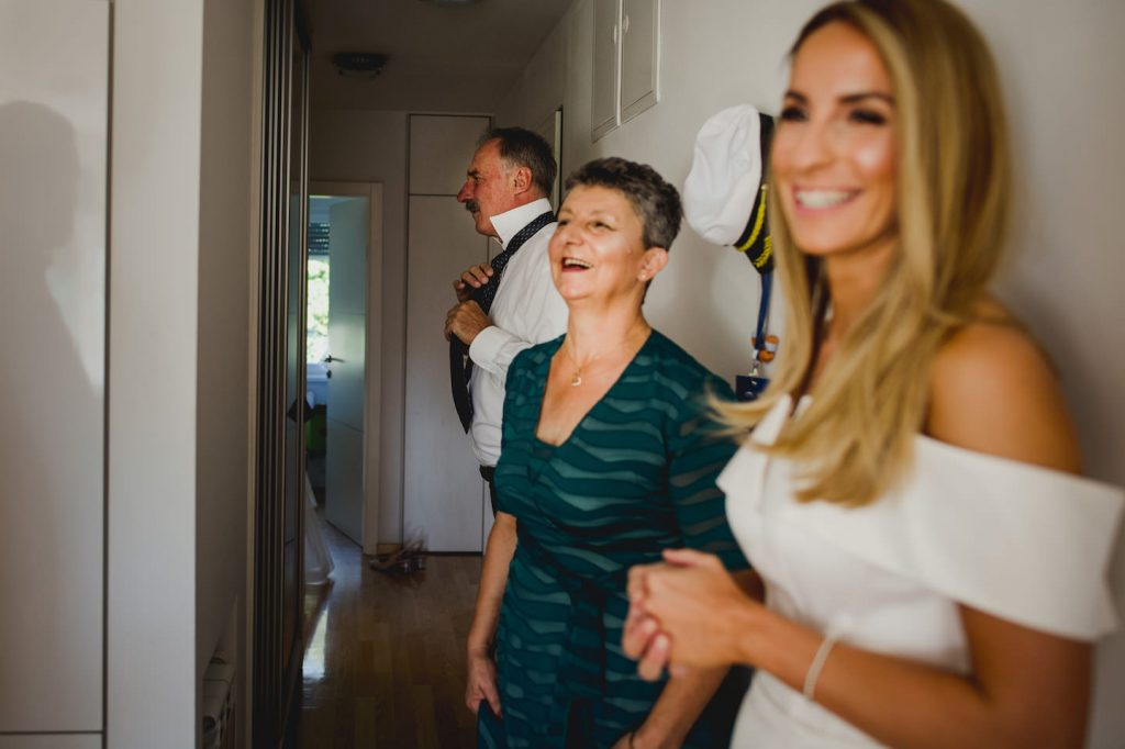 parents of a bride getting ready and laughing