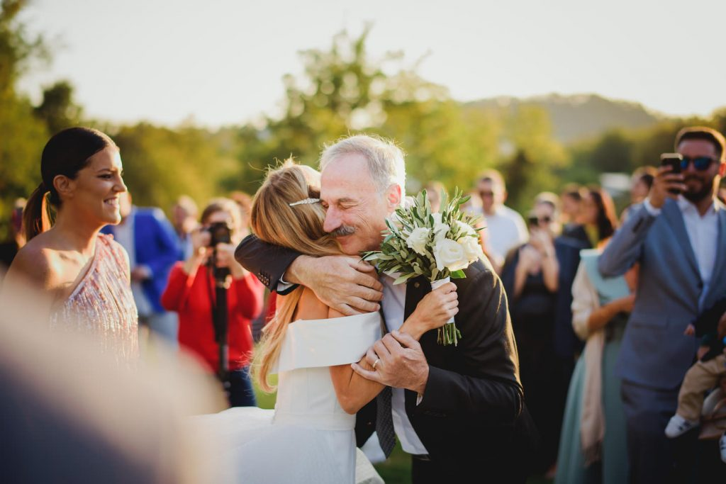 bride and her father hugging as he is giving her away to the groom