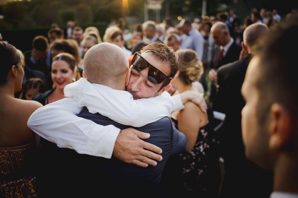 groom and friend hugging