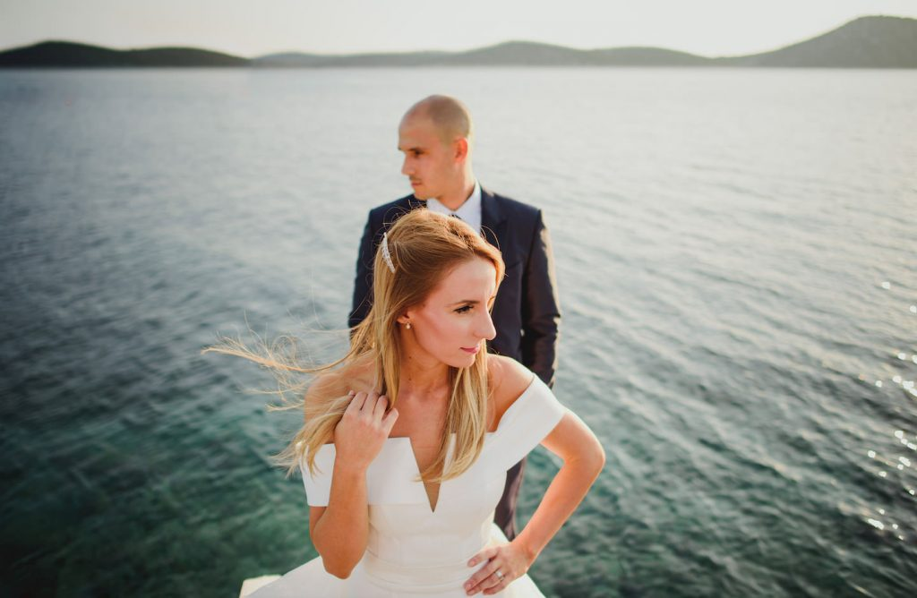 bride and groom in a pier
