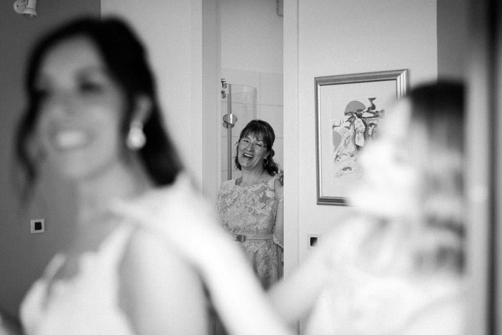 mother of bride looking at bride with admiration